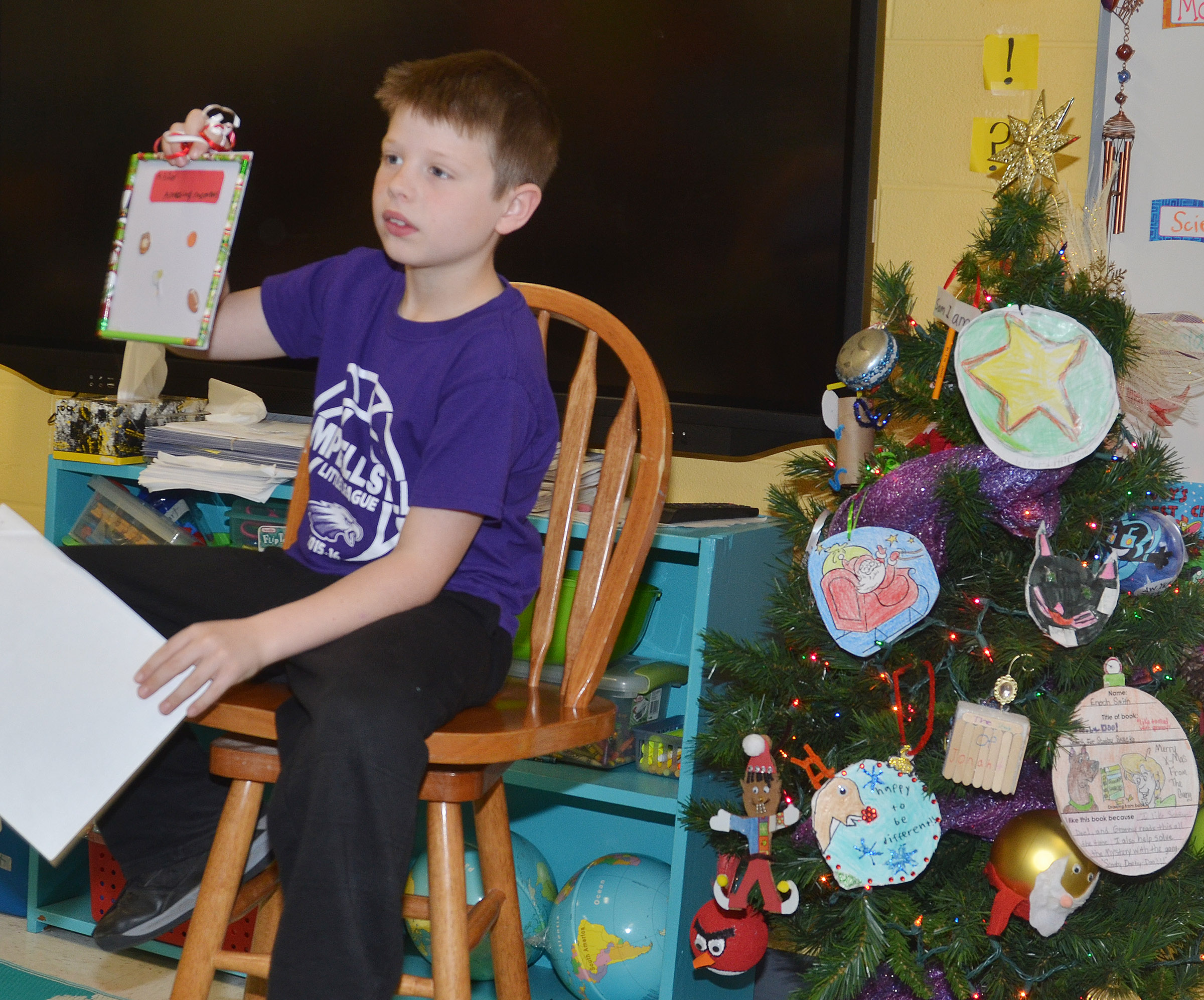 CES second-grader Brody Sidebottom tells his classmates about his ornament.