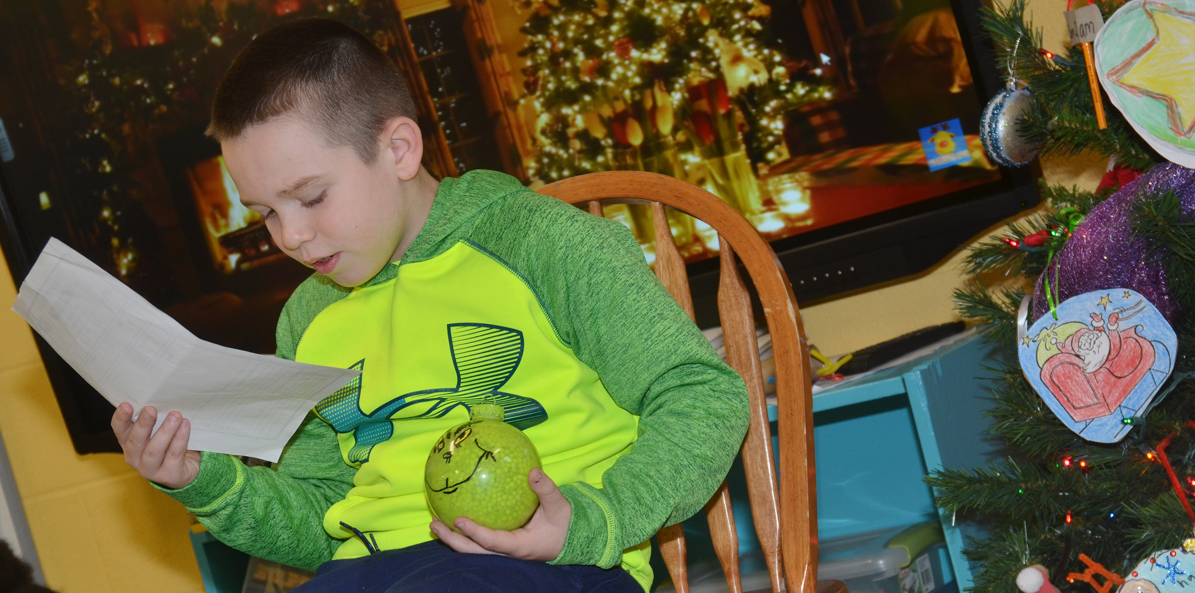 CES second-grader Colton Maggard tells his classmates about his ornament.