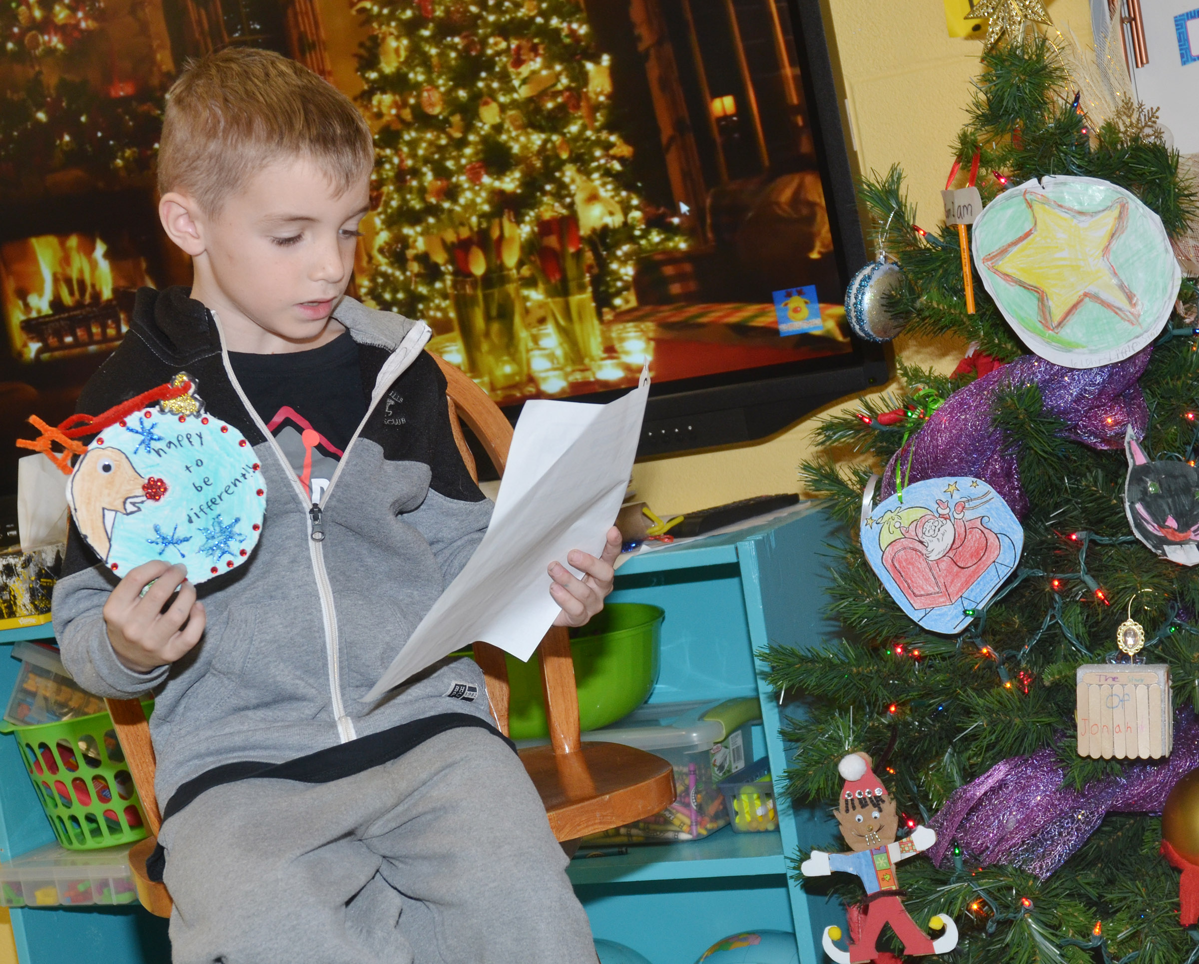 CES second-grader Ben Lord tells his classmates about his ornament.