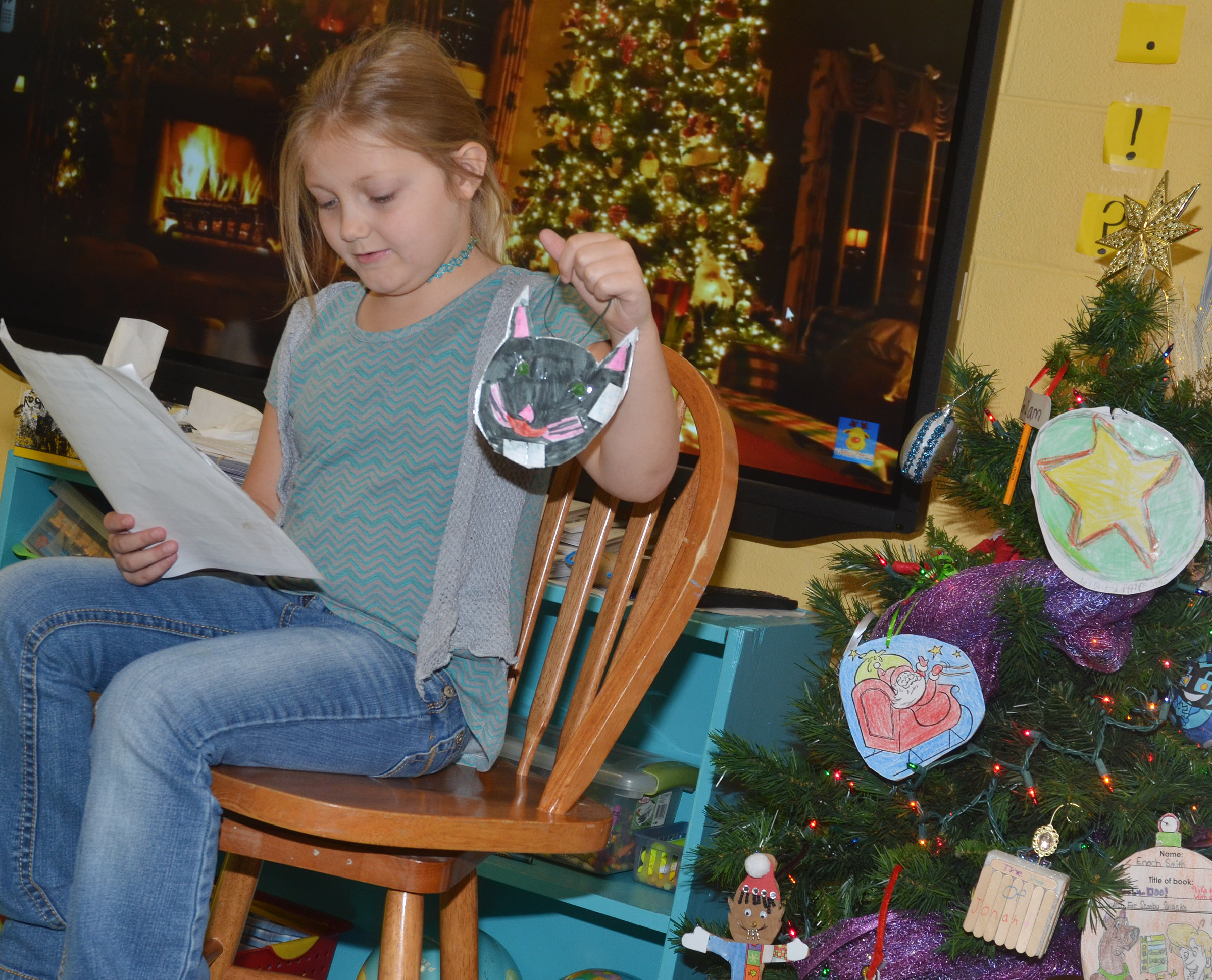 CES second-grader Asia Singleton tells her classmates about her ornament.