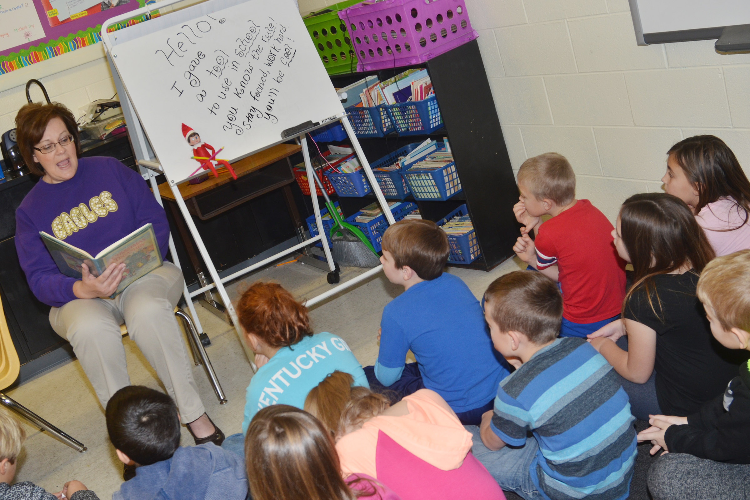 CES second-grade teacher Tonya Hagan reads to her students about Christmas traditions.