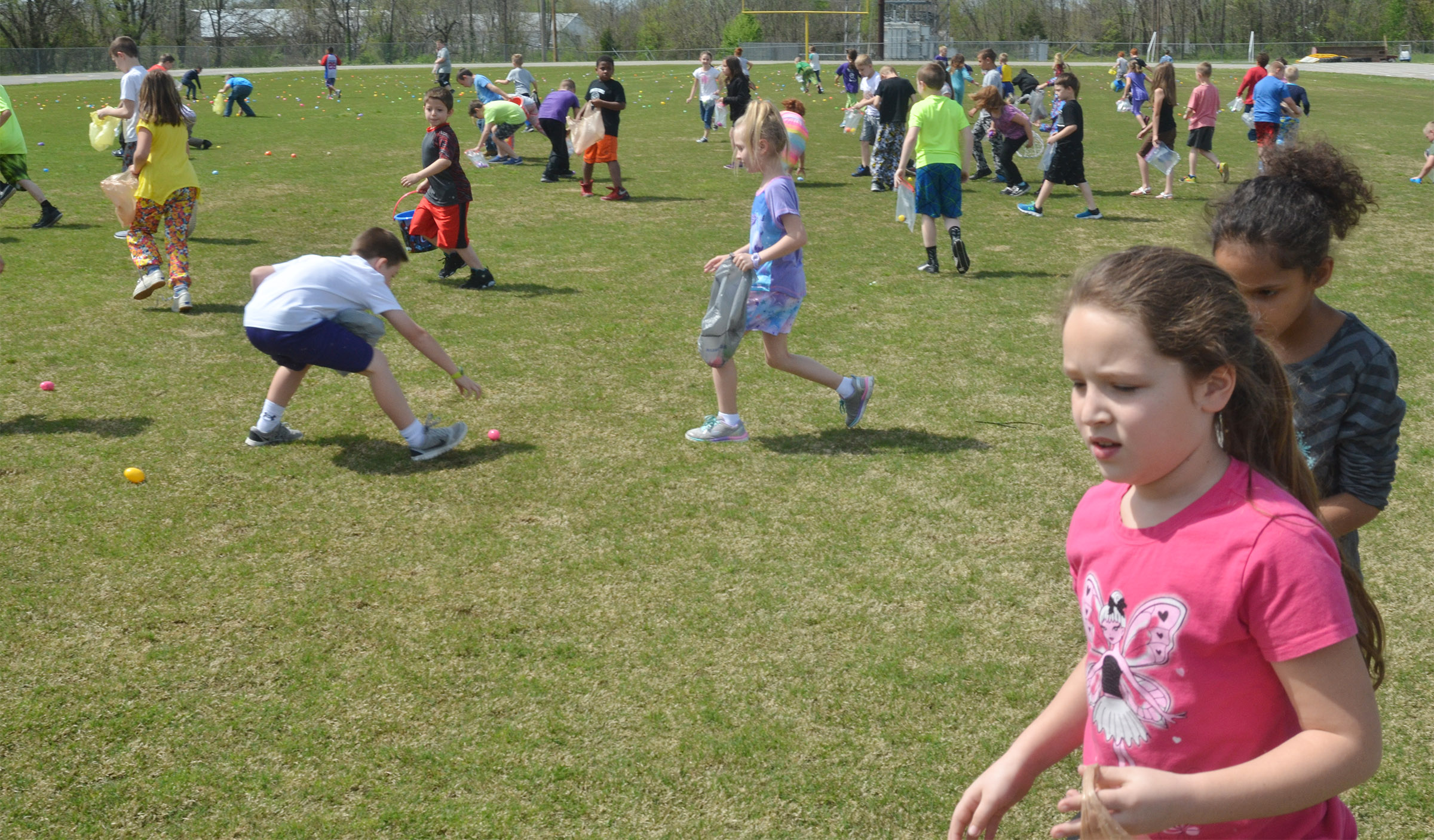 CES second-graders hunt for Easter eggs.
