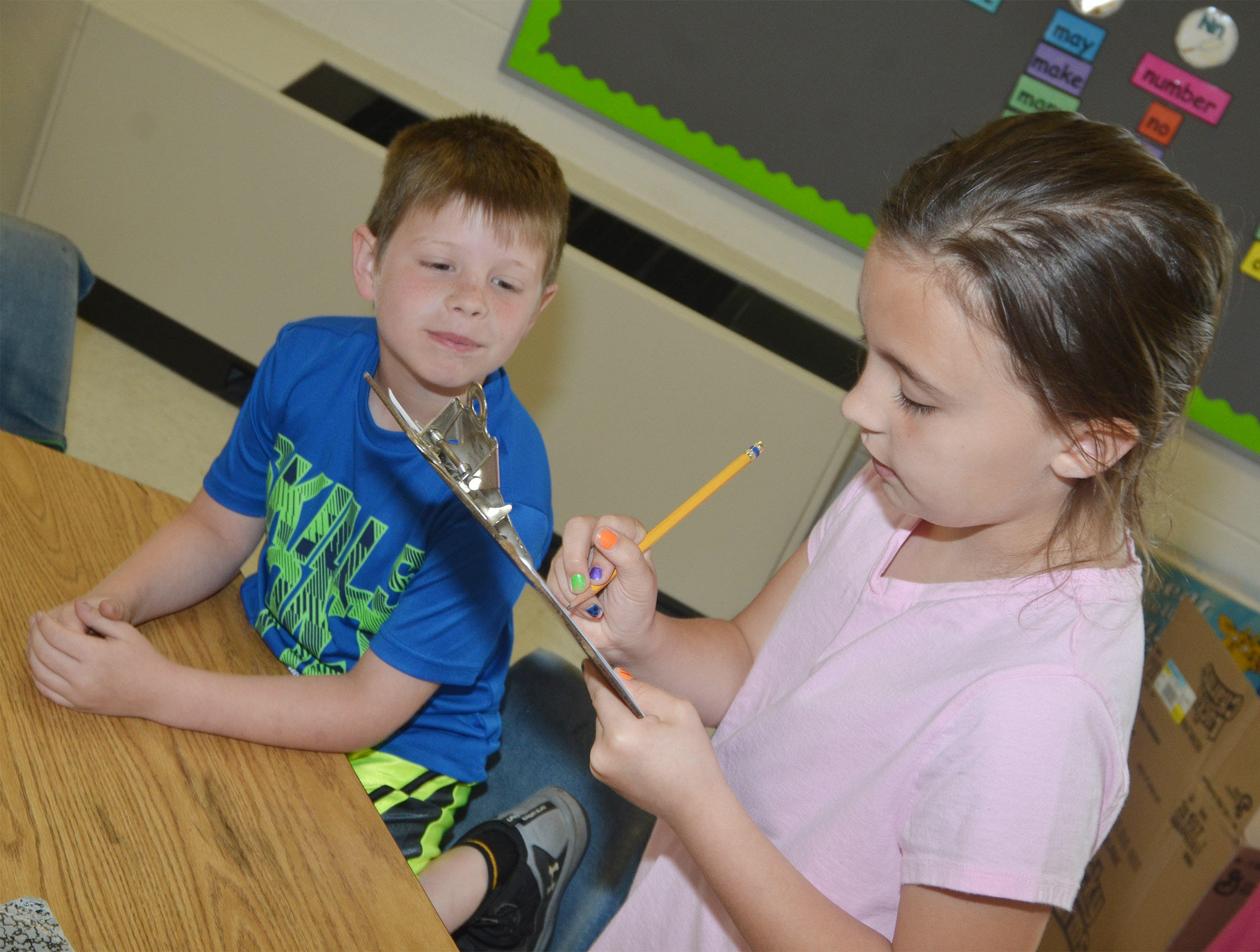 CES second-grader Annabelle Brockman interviews first-grader Brody Sidebottom.