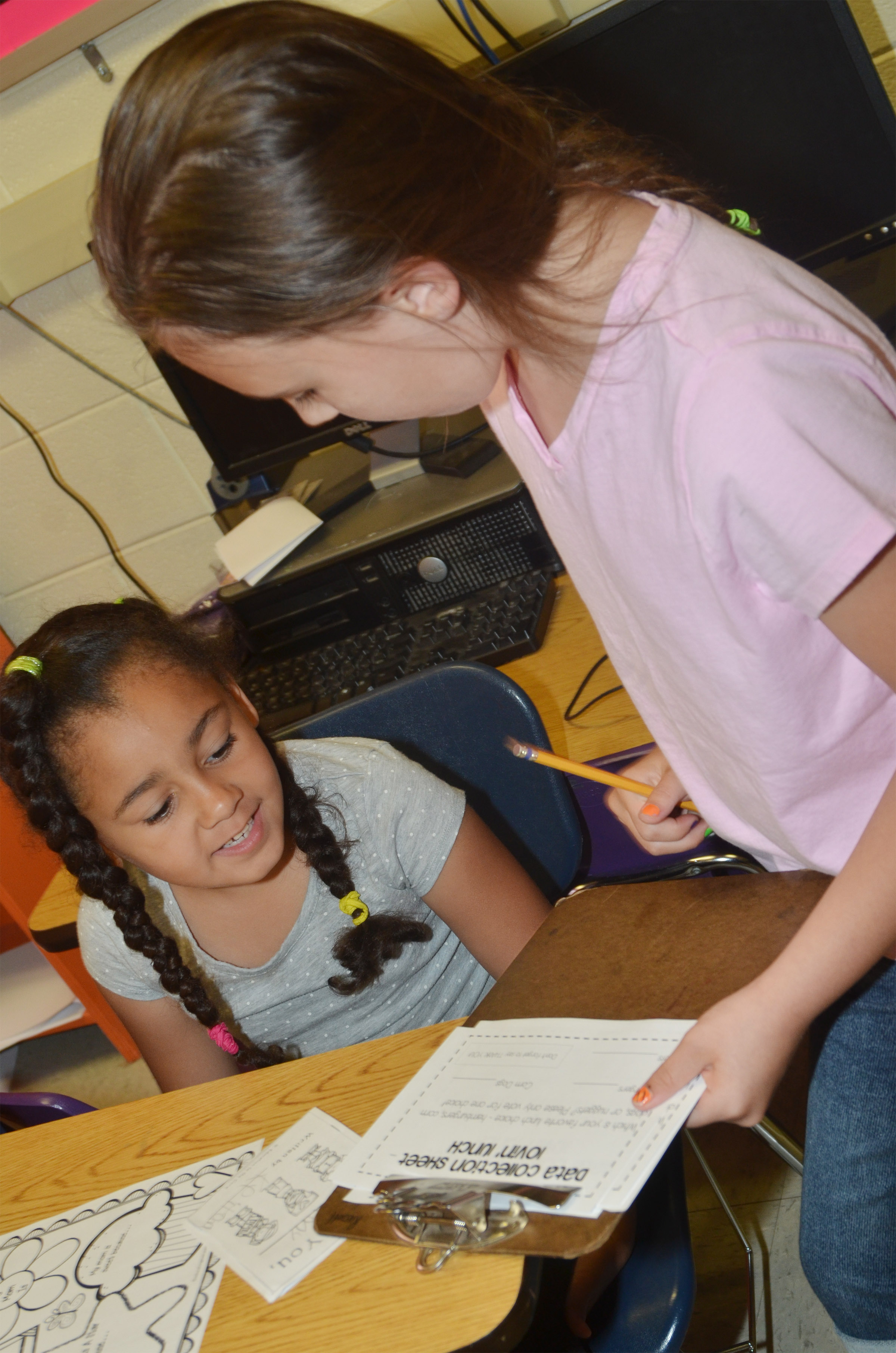 CES second-grader Annabelle Brockman interviews first-grader Keitona Whitehead.