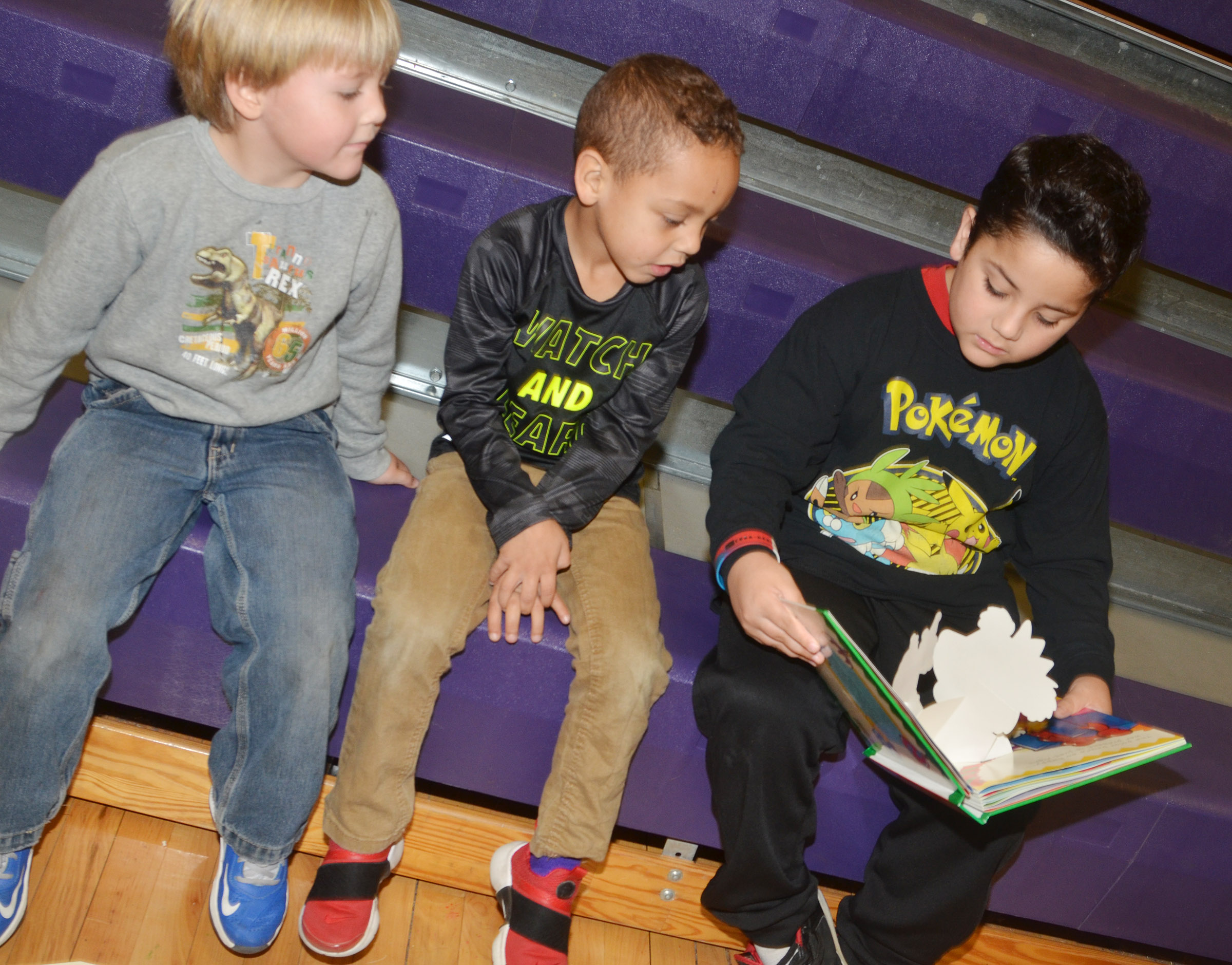 CES second-grader Nicholas Almeida reads to preschool students Bentley Cox, at left, and Jasiahas Anderson.