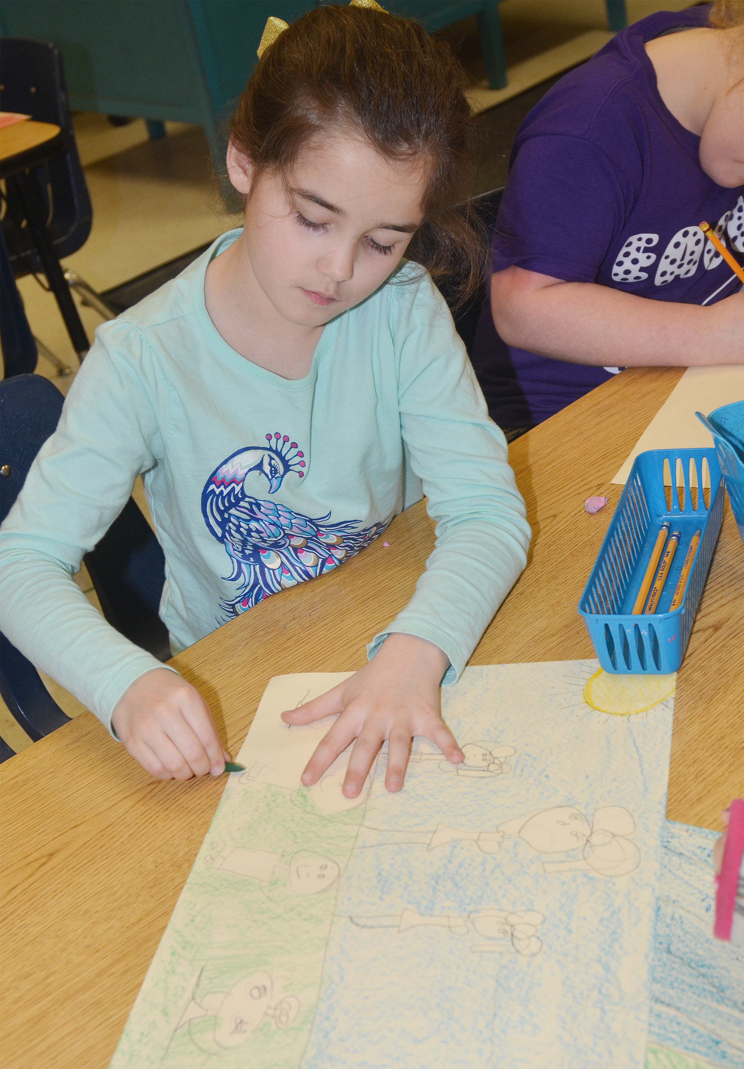 CES third-grader Alexis Wolford draws her mural of what she enjoys doing in Campbellsville.