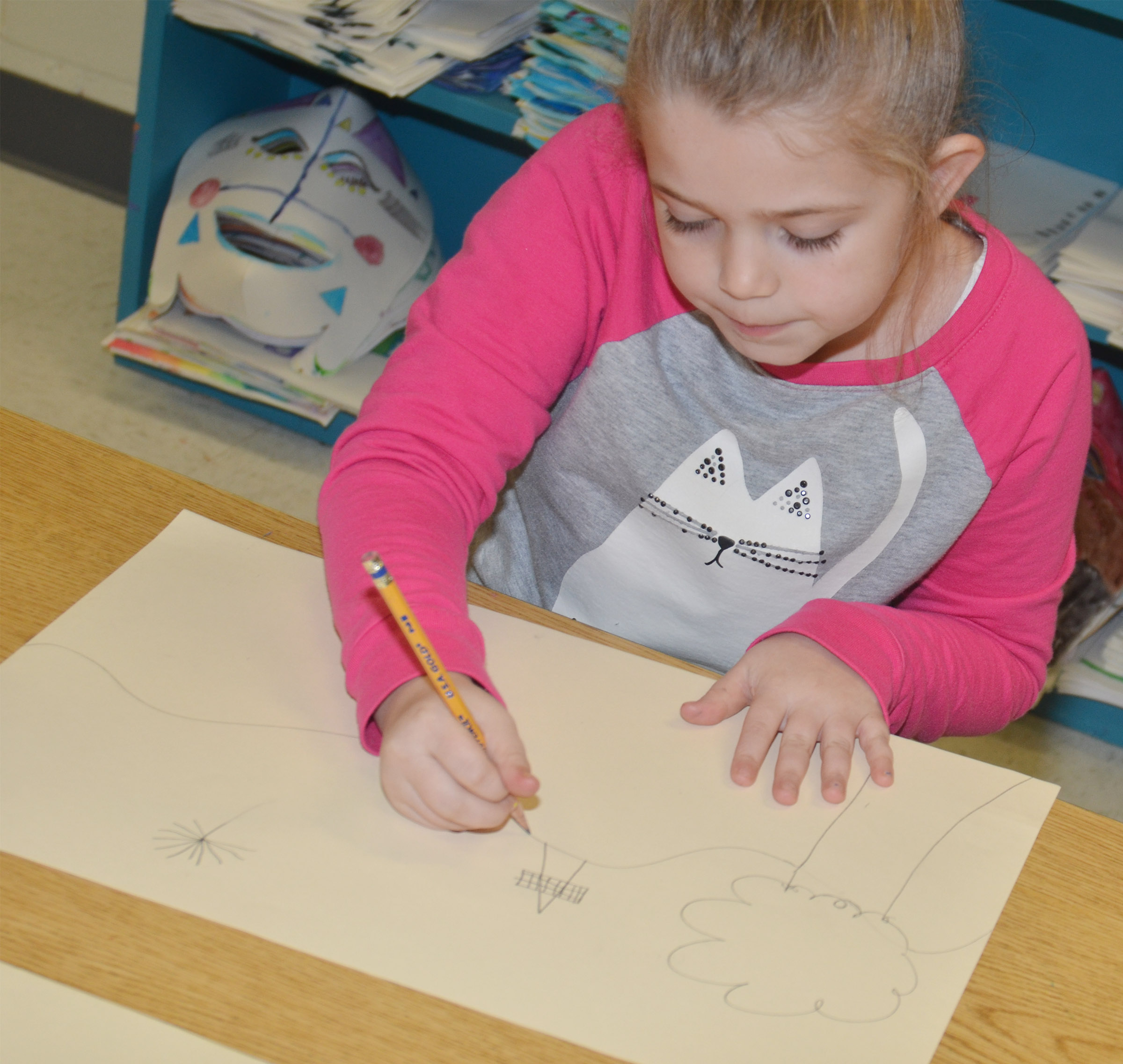 CES third-grader Chyanne Christie draws her mural of what she enjoys doing in Campbellsville.