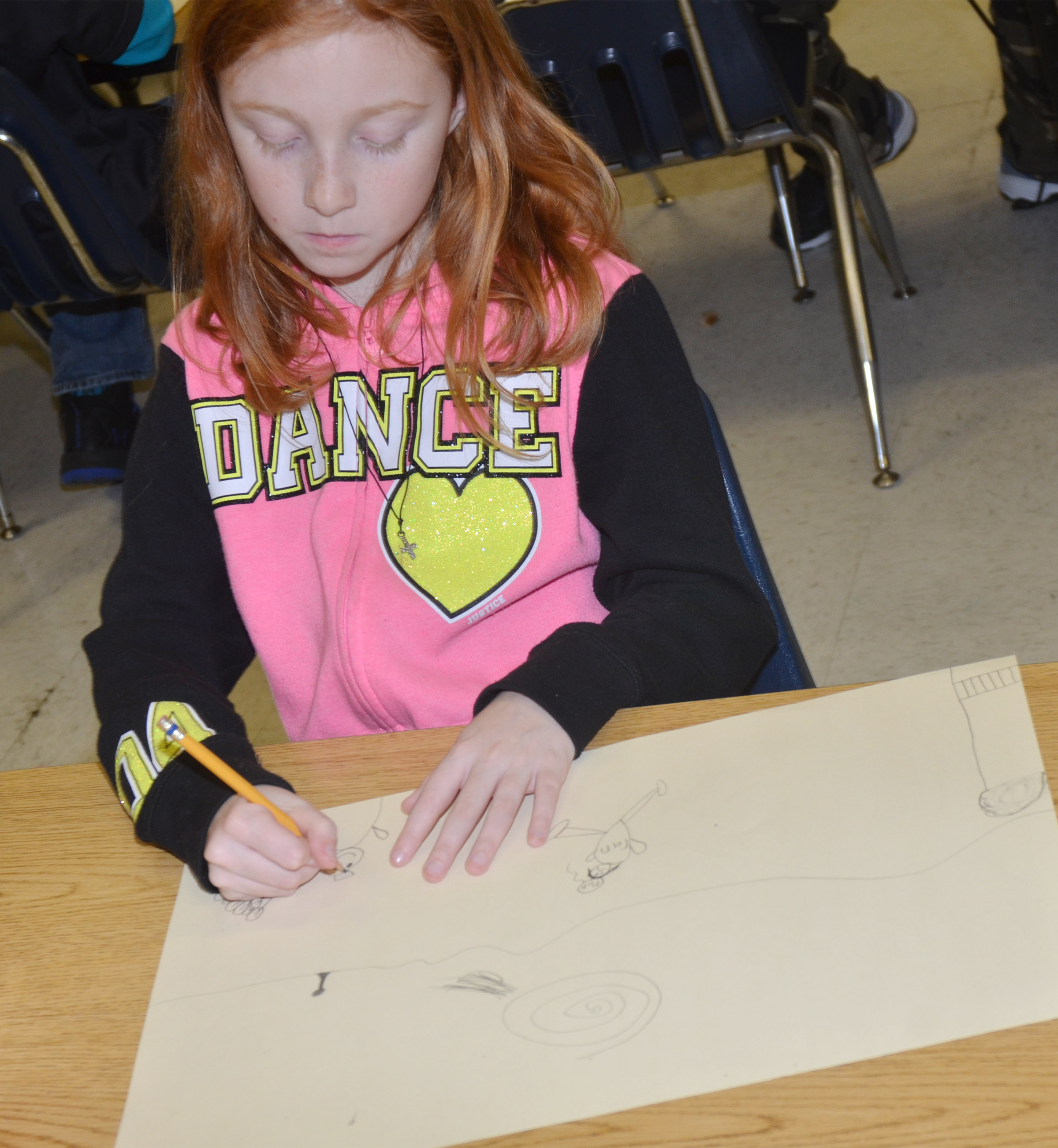CES third-grader Savannah Wethington draws her mural of what she enjoys doing in Campbellsville.