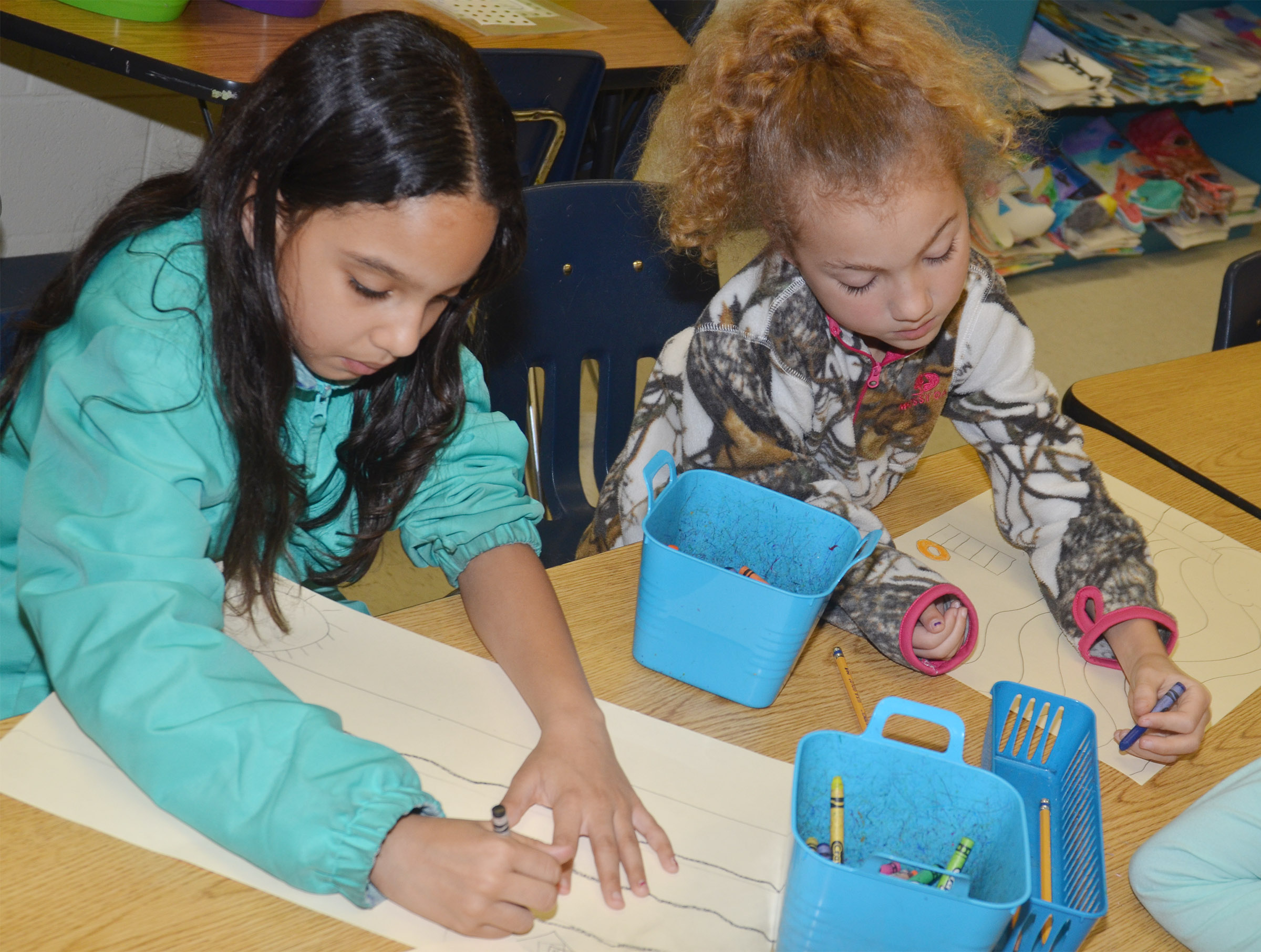 CES third-graders Alyssa Knezevic, at left, and Raelyn Dunn draw their murals of what they enjoy doing in Campbellsville.