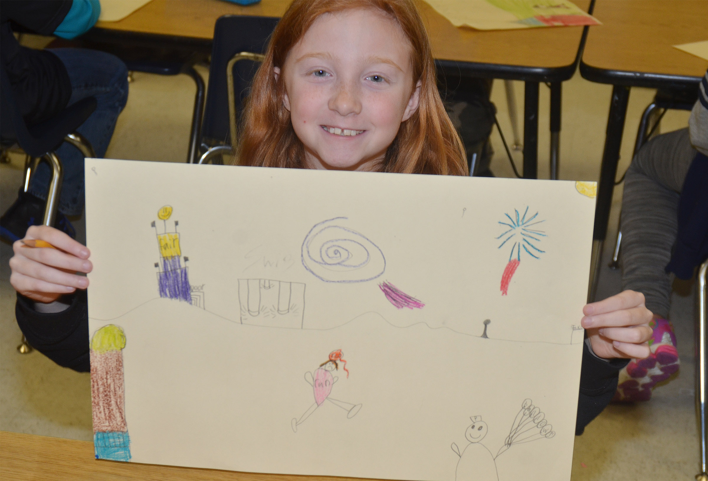 CES third-grader Savannah Wethington shows her mural of what she enjoys doing in Campbellsville.