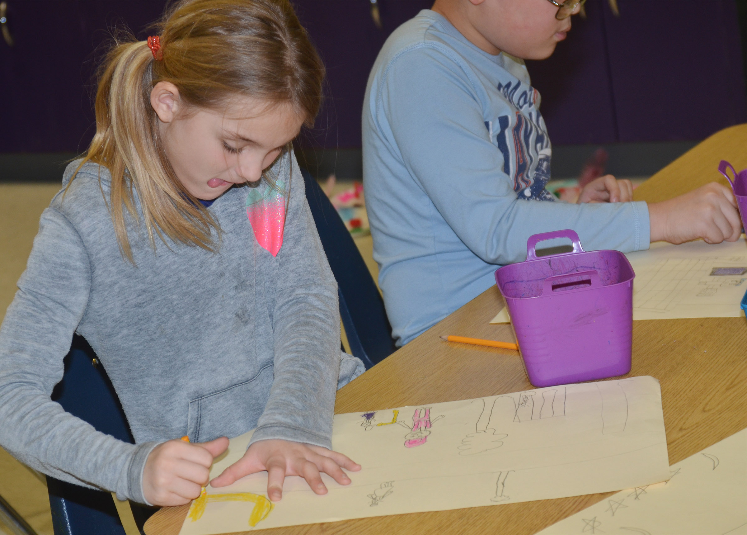 CES third-grader Miranda Edwards draws her mural of what she enjoys doing in Campbellsville.