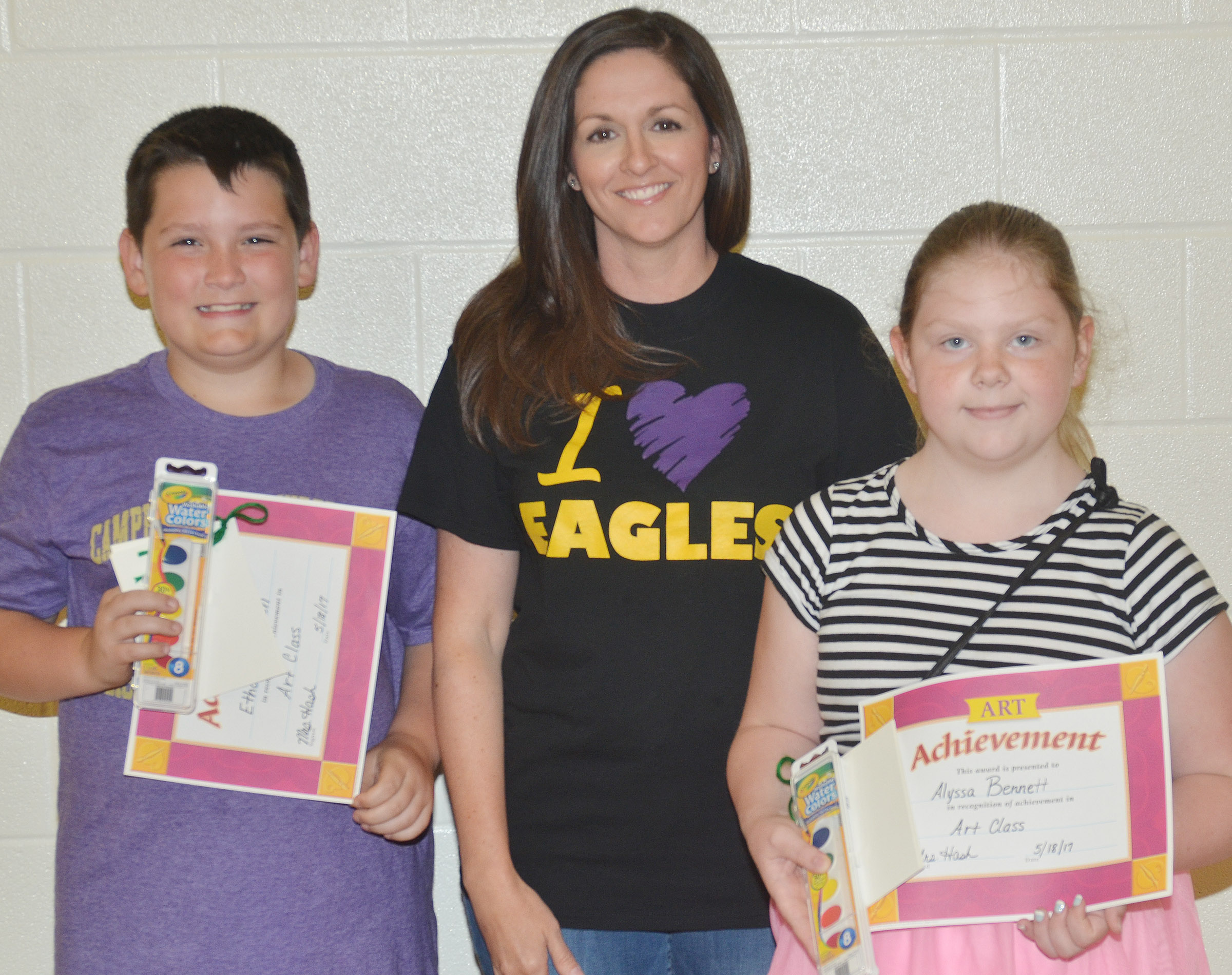 Art award winners, pictured with teacher Adrienne Hash, are Ethan Garrison and Alyssa Bennett.