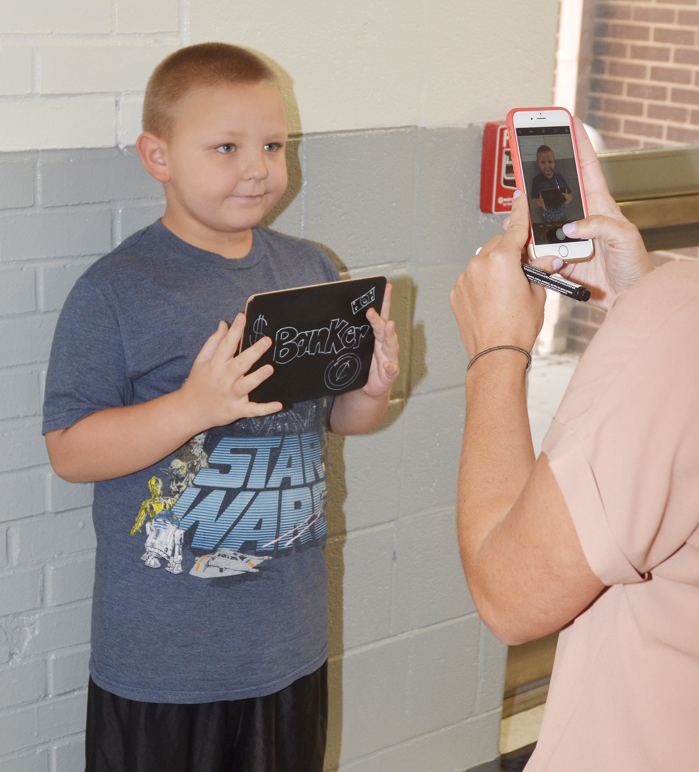 CES third-grader Peyton Mitchell, who wants to be a banker when he gets older, smiles for a photo.