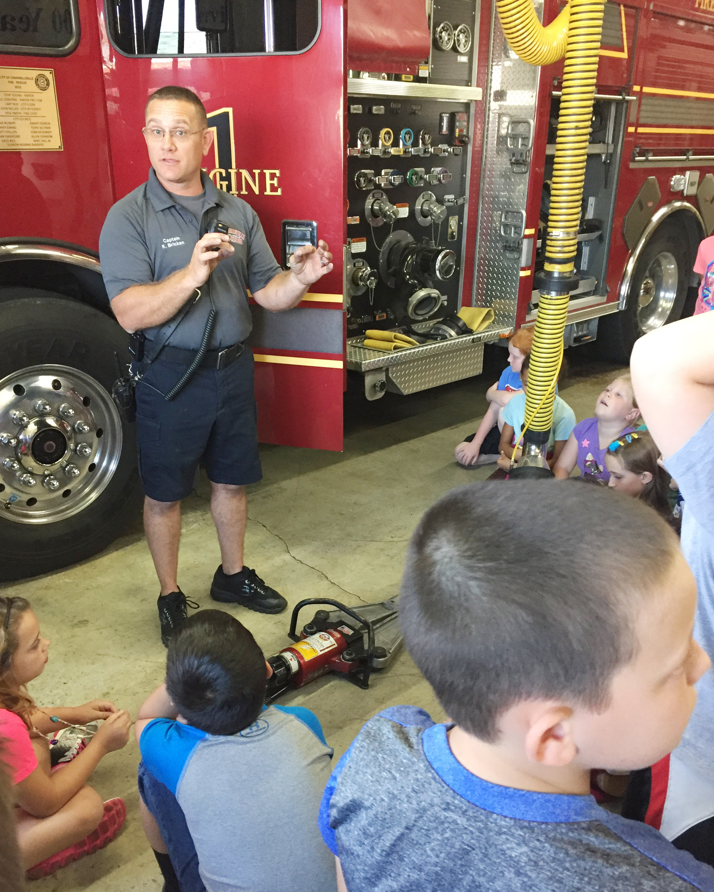 Campbellsville Fire & Rescue Captain Keith Bricken talks to CES third-graders about the equipment that he and his fellow firefighters use.