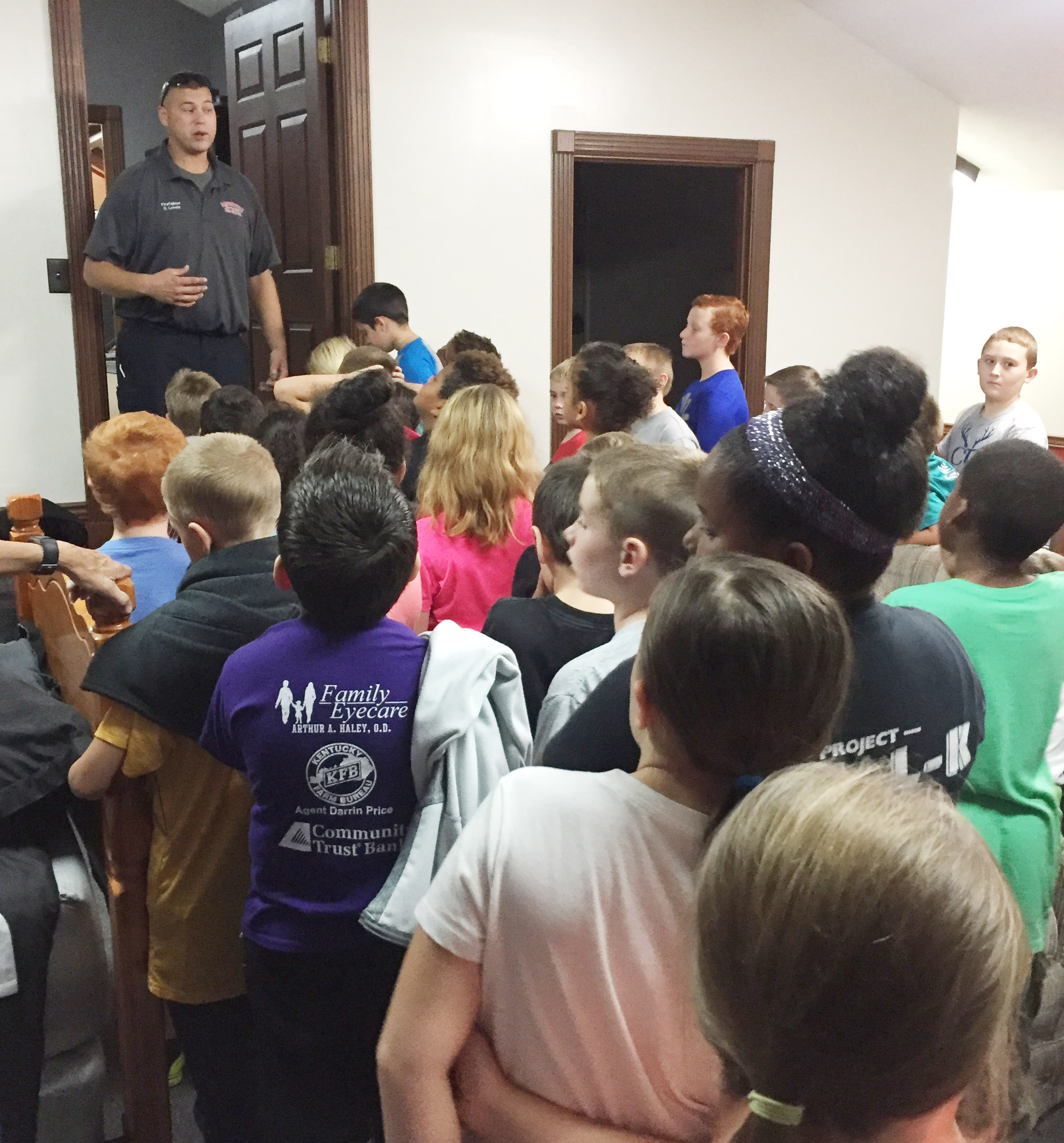 Campbellsville Fire & Rescue Firefighter Daniel Lovett shows CES third-graders where he and his fellow firefighters sleep.