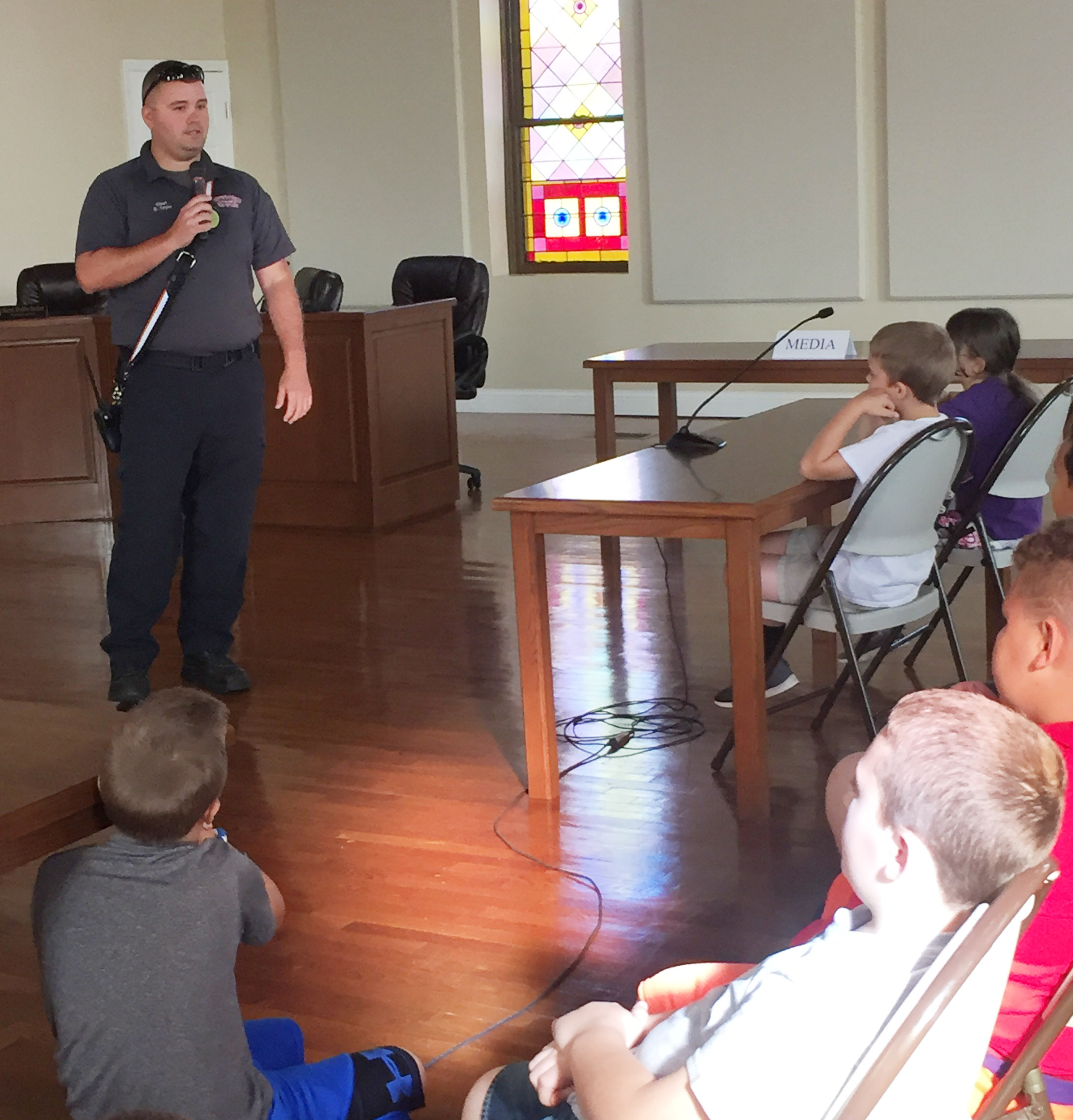 Campbellsville Fire & Rescue Chief Chris Taylor talks to CES third-graders about how he and his fellow firefighters keep people safe.
