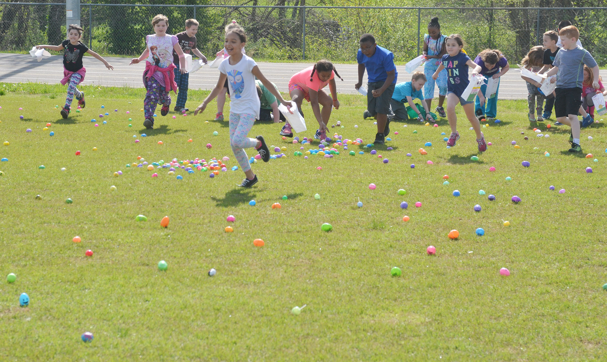 CES third-graders hunt for Easter eggs.
