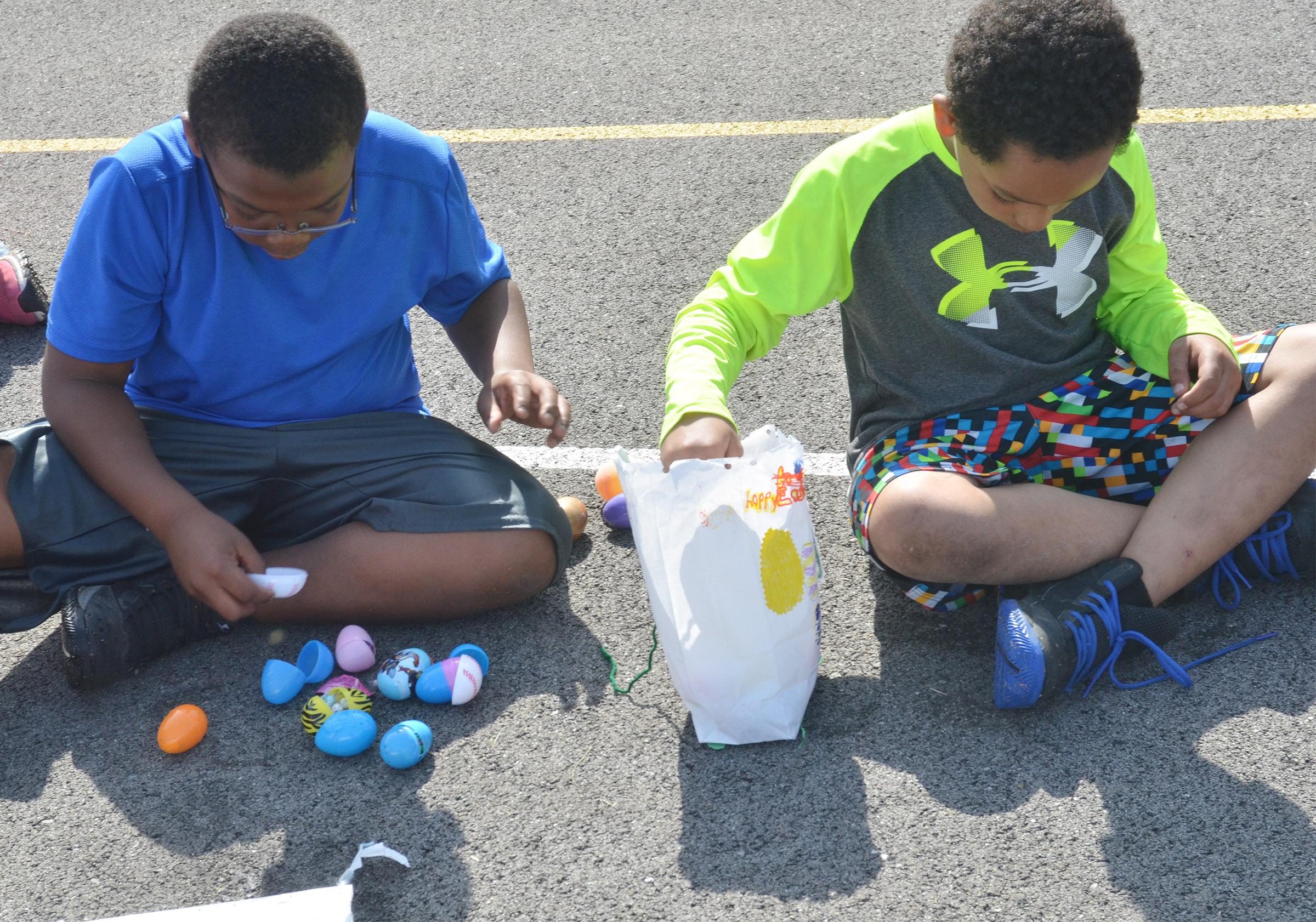 CES third-graders Austin Sloan, at left, and Anthony Goins count their Easter eggs.