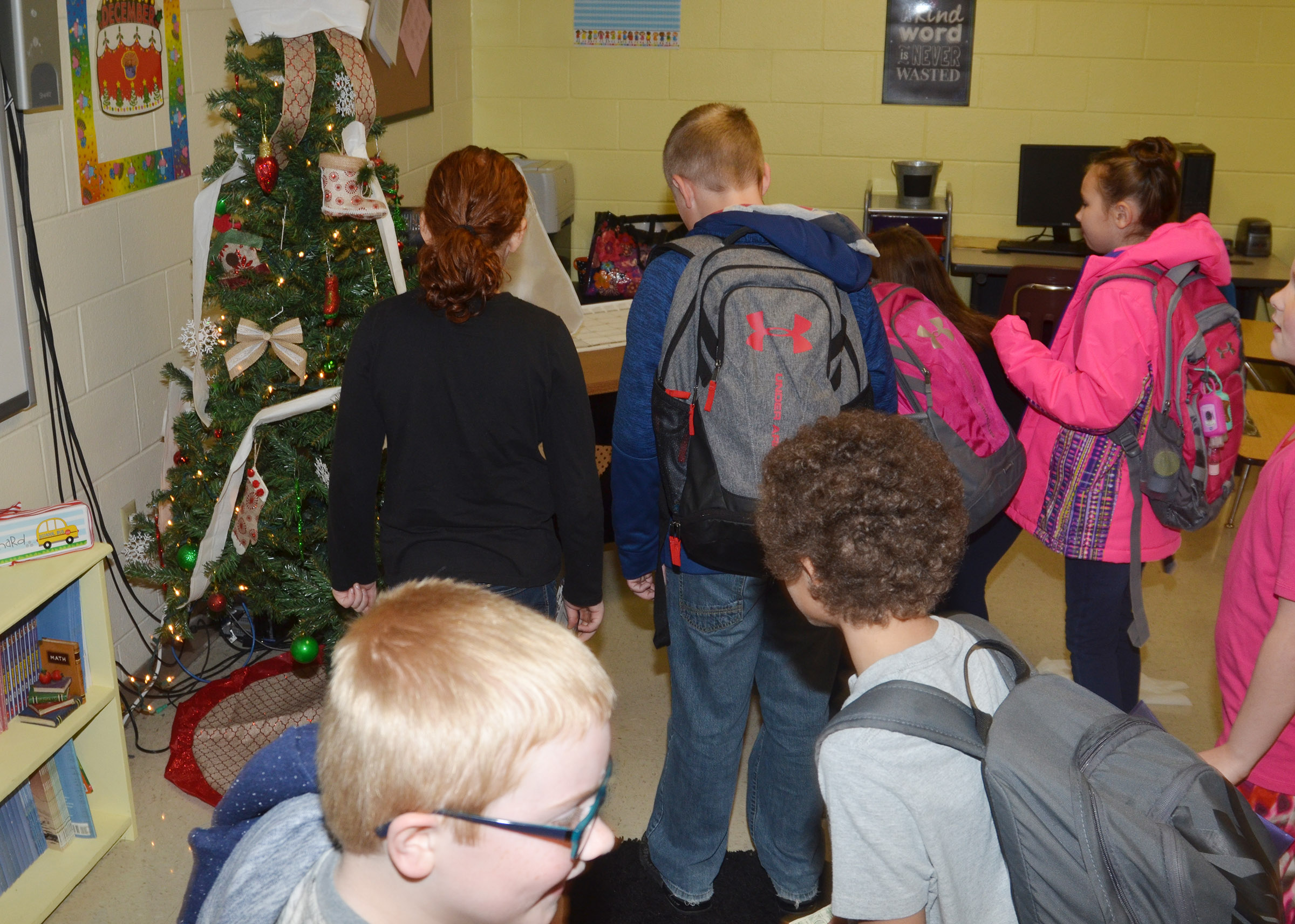 CES third-graders in Keri Richard's class came to school recently and found their elf had thrown toilet paper all over their classroom.