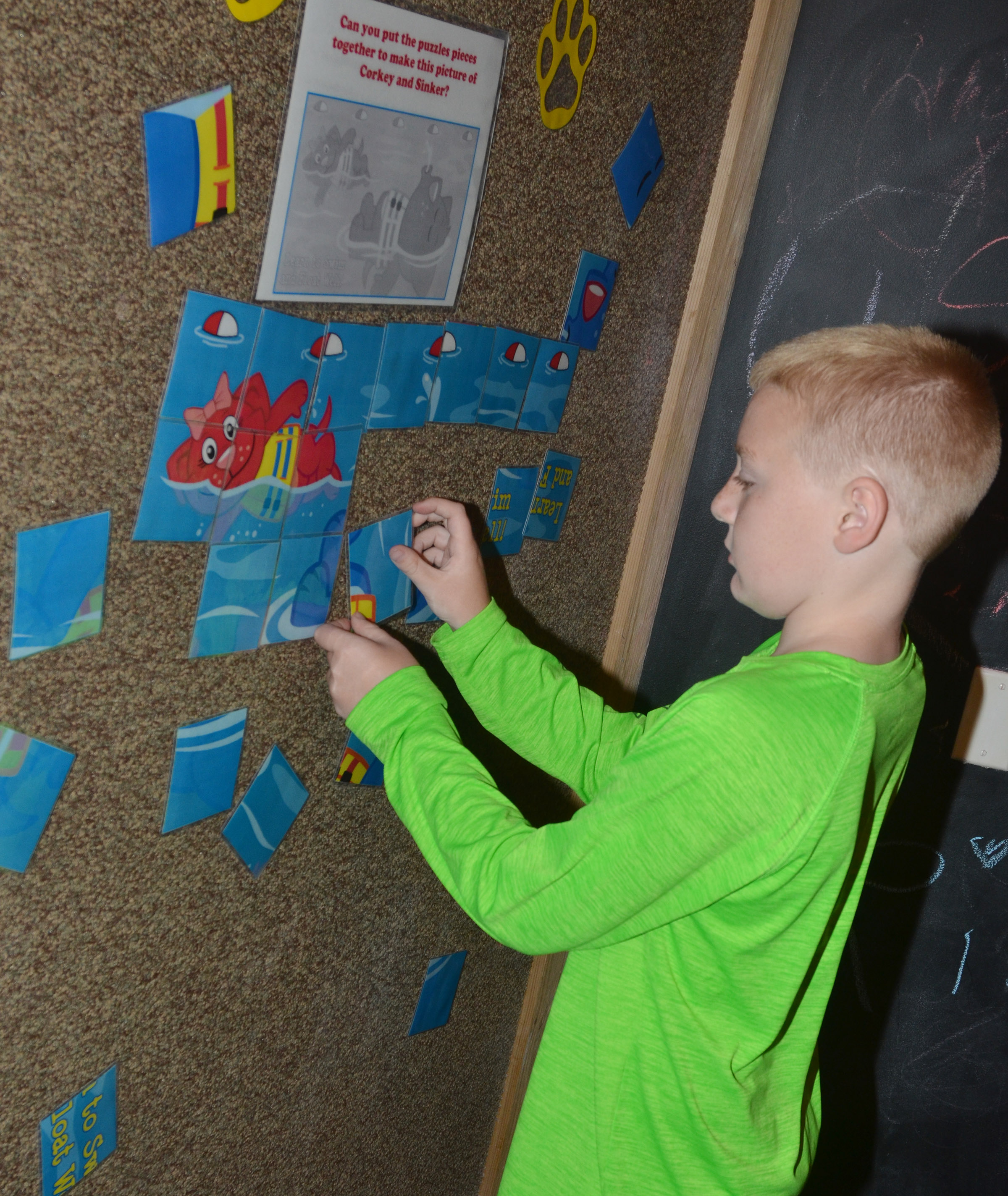 CES third-grader Ryder Murphy works a puzzle at the Green River Lake Visitor Center.