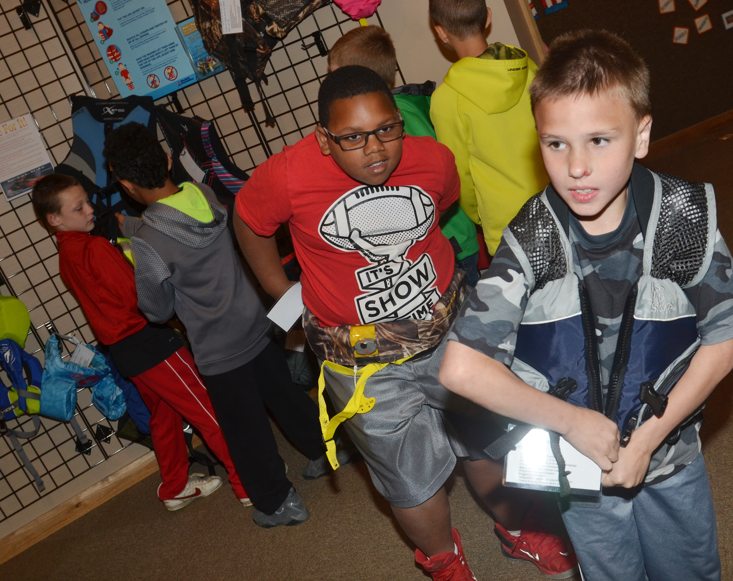 CES third-graders Malikiah Spurling, at left, and Jayden Harris try on life jackets at the Green River Lake Visitor Center.
