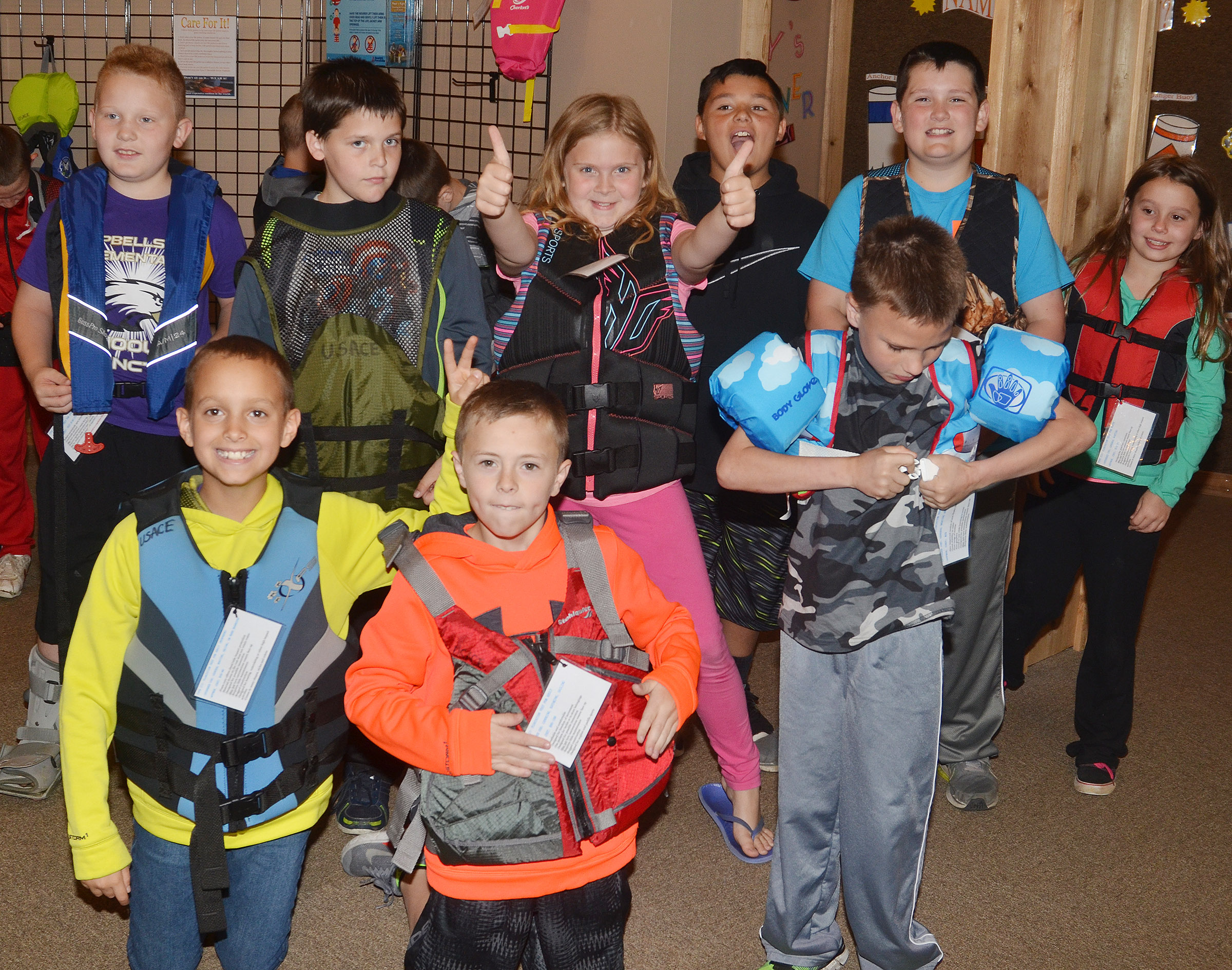 CES third-graders try on life jackets at the Green River Lake Visitor Center. From left, front, are Bradley Paris, Keaton Hord and Jayden Harris. Back, Isaiah Jeffries, Chris Brown, Arianna Childers, Brayden Paiz, Ethan Garrison and McKailynn Grubaugh.