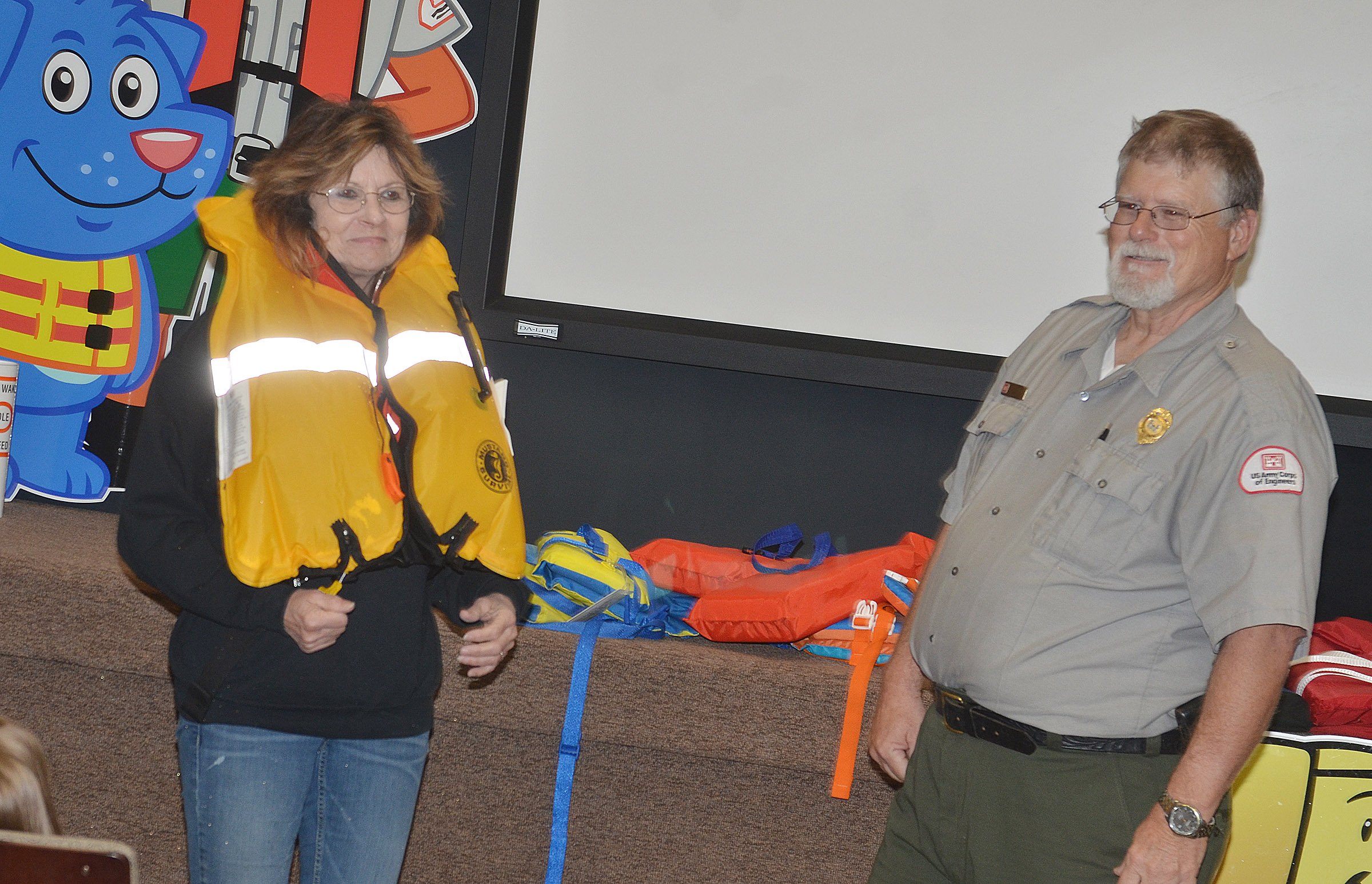 Park Ranger David Goode tells CES third-grade teacher Marcia Sharp to inflate her life jacket.