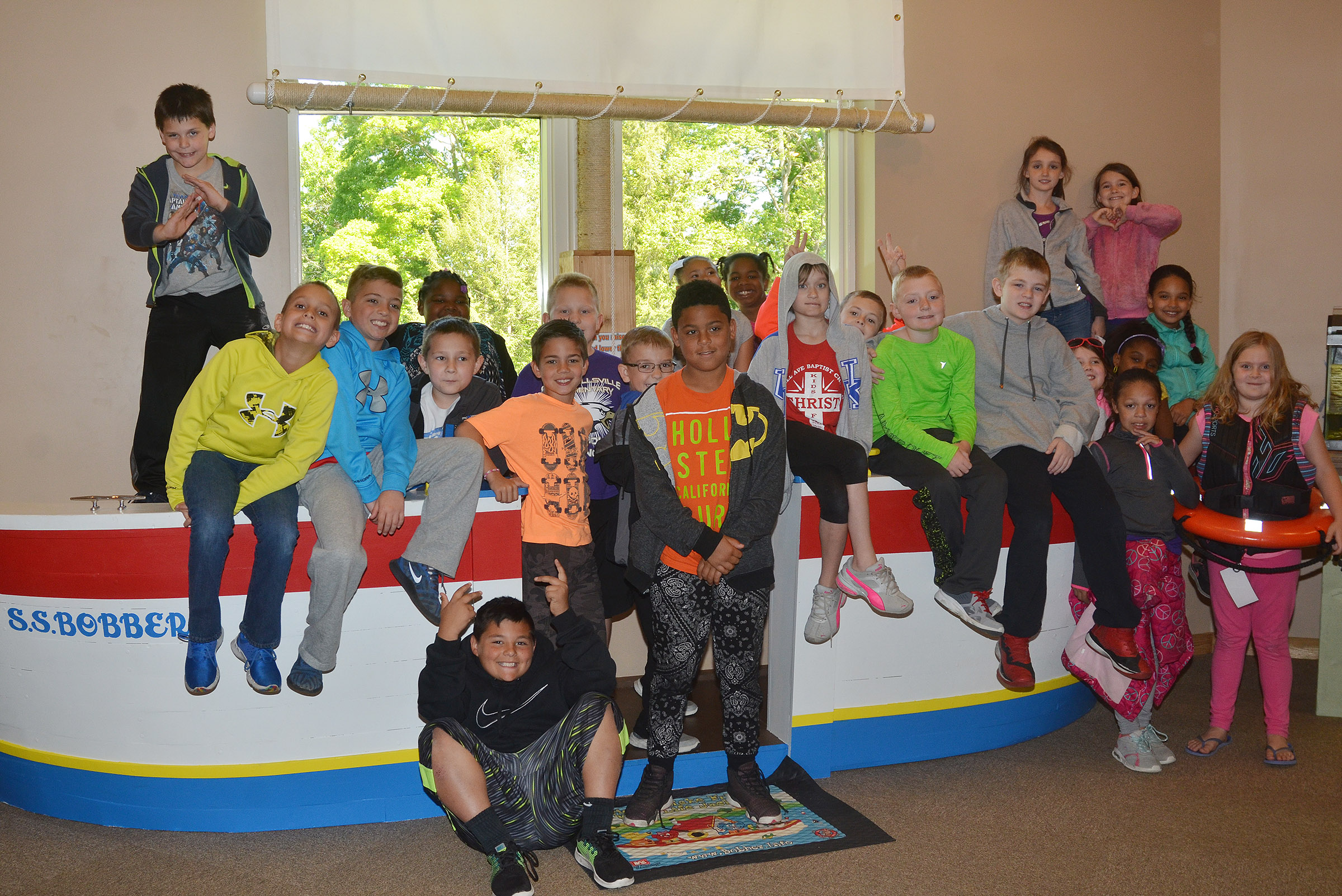 CES third-graders in Hannah Jones's class pose for a photo aboard the S.S. Bobber at the Green River Lake Visitor Center.