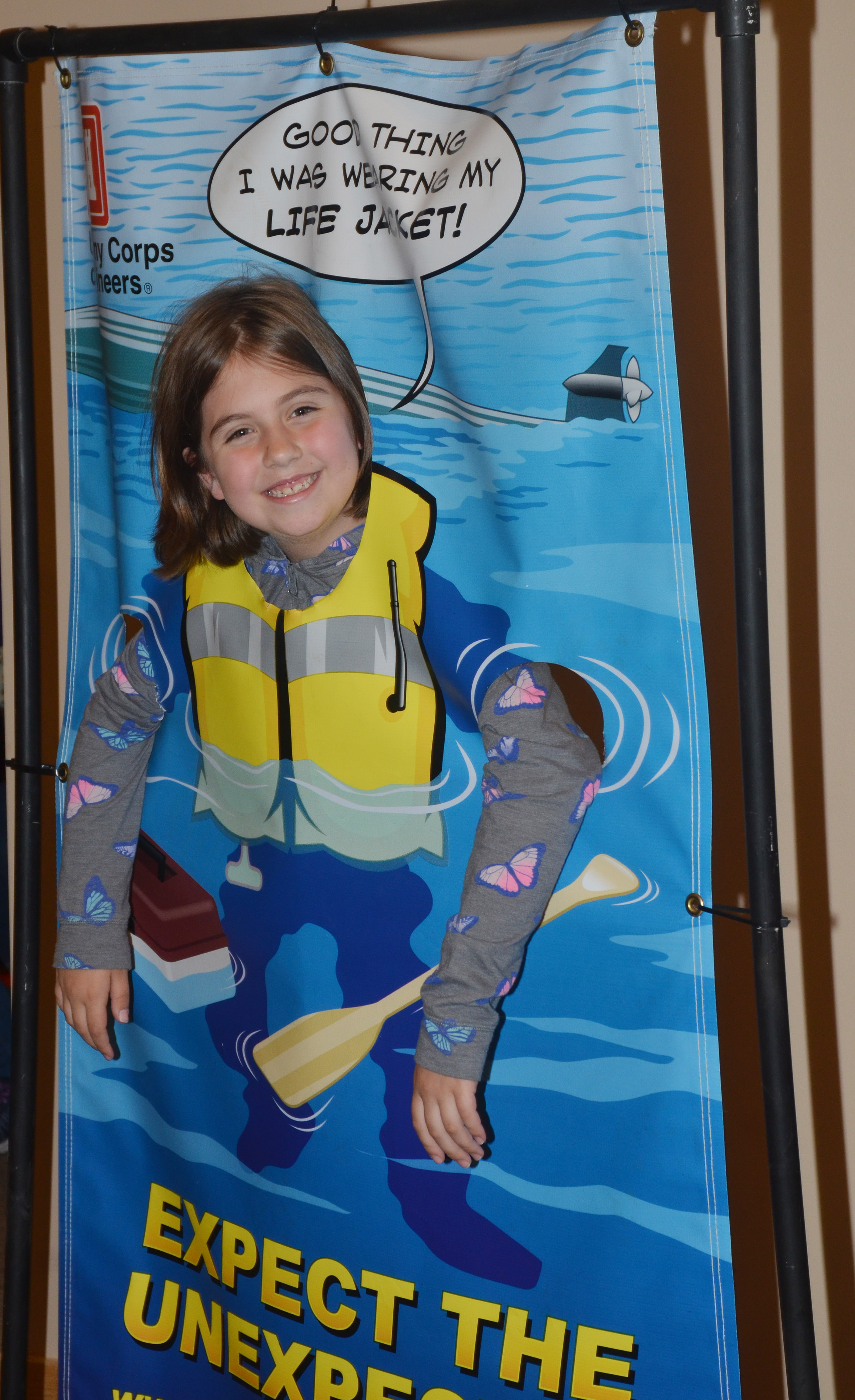 CES third-grader Adrianna Garvin poses for a photo wearing a life jacket at the Green River Lake Visitor Center.