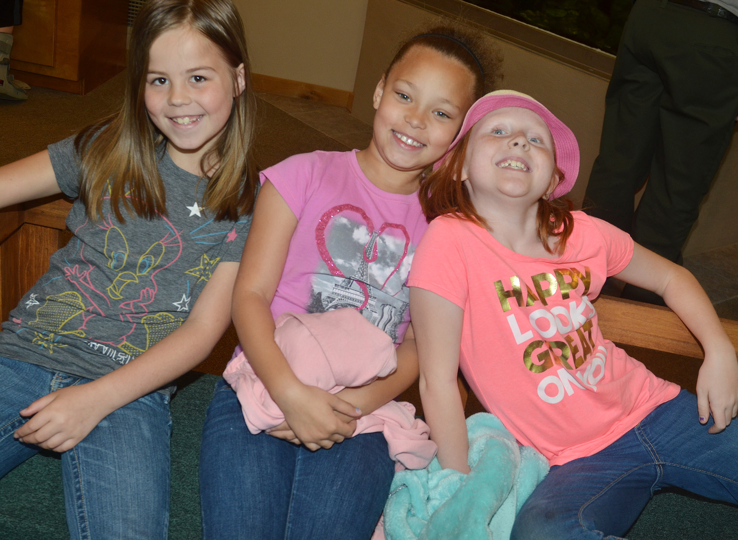 From left, CES third-graders Chloe Bates, Alexis Graves and Nora Harris have fun at the Green River Lake Visitor Center.
