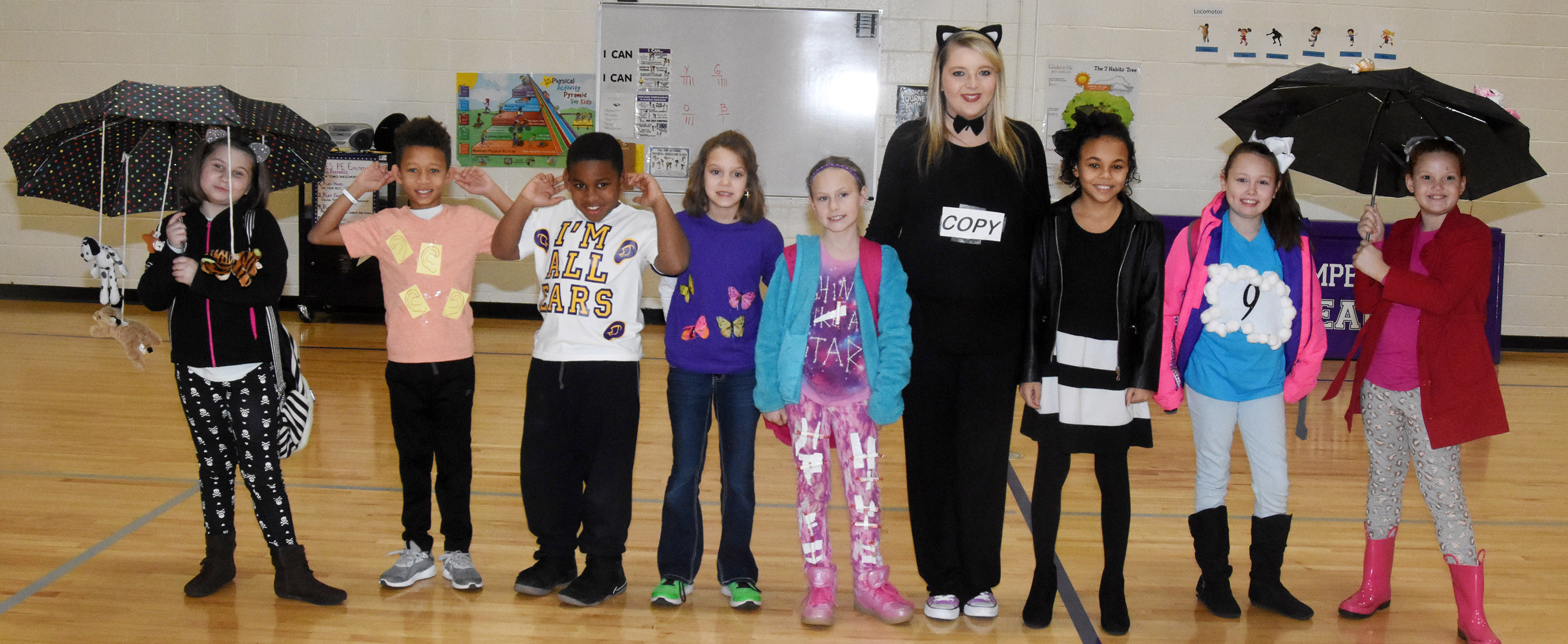 CES third-graders in Keri Richards's class dress to represent their favorite idioms. From left are Natalia West, Rajon Taylor, Elijah Spurling, Baylee Pike, Rebecca Ray, teacher Keri Richard, Braelyn Taylor, River McFarland and Analeigh Foster.