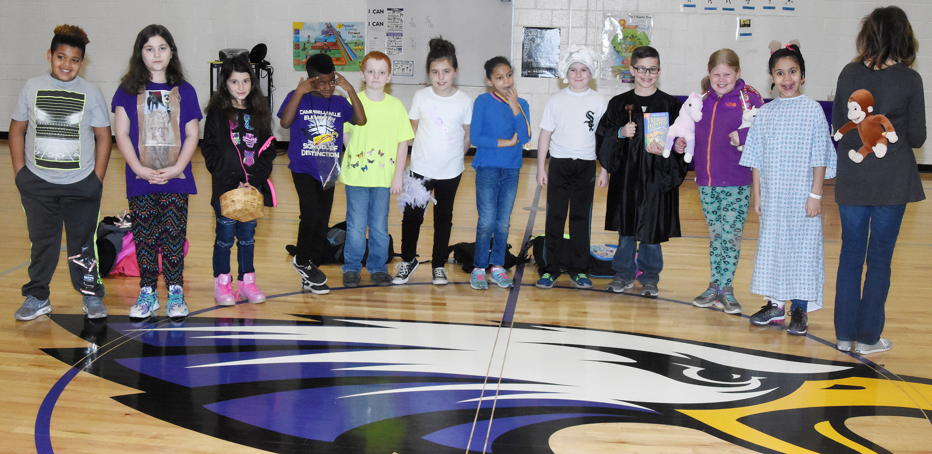 CES third-graders in Marcia Sharp's class dress to represent their favorite idioms. From left are Jayden Moore, Abigail Hoppes, Ava Taylor, Kae'vin Spaulding, Gavin Martin, Annabelle Brockman, Malia Thompson, Stephen Green, Tye Rhodes, Lily Coots, Alex Wilson and teacher Marcia Sharp.