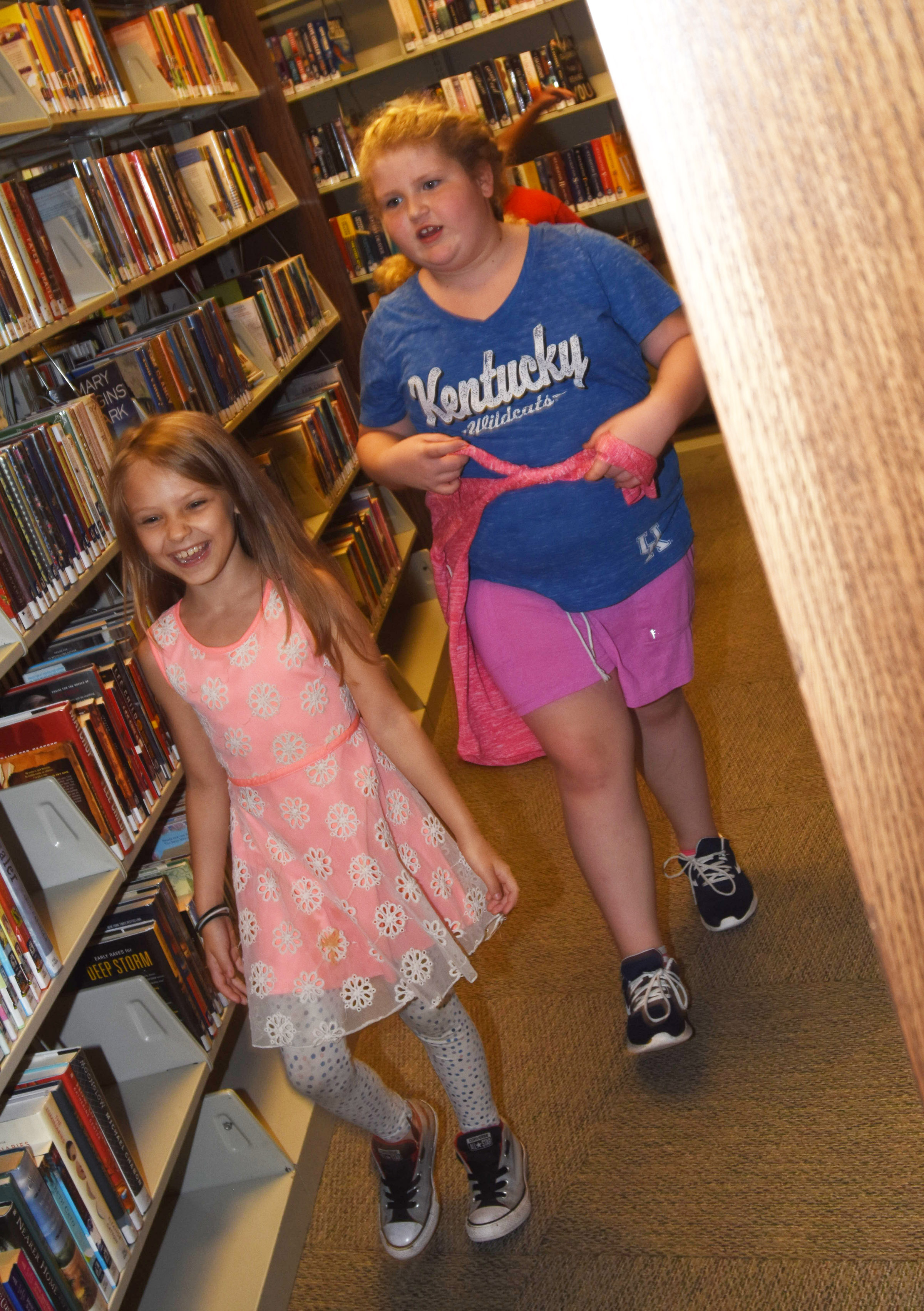 CES third-graders Chloe Harvey, at left, and Elizabeth Foster tour the Taylor County Public Library.