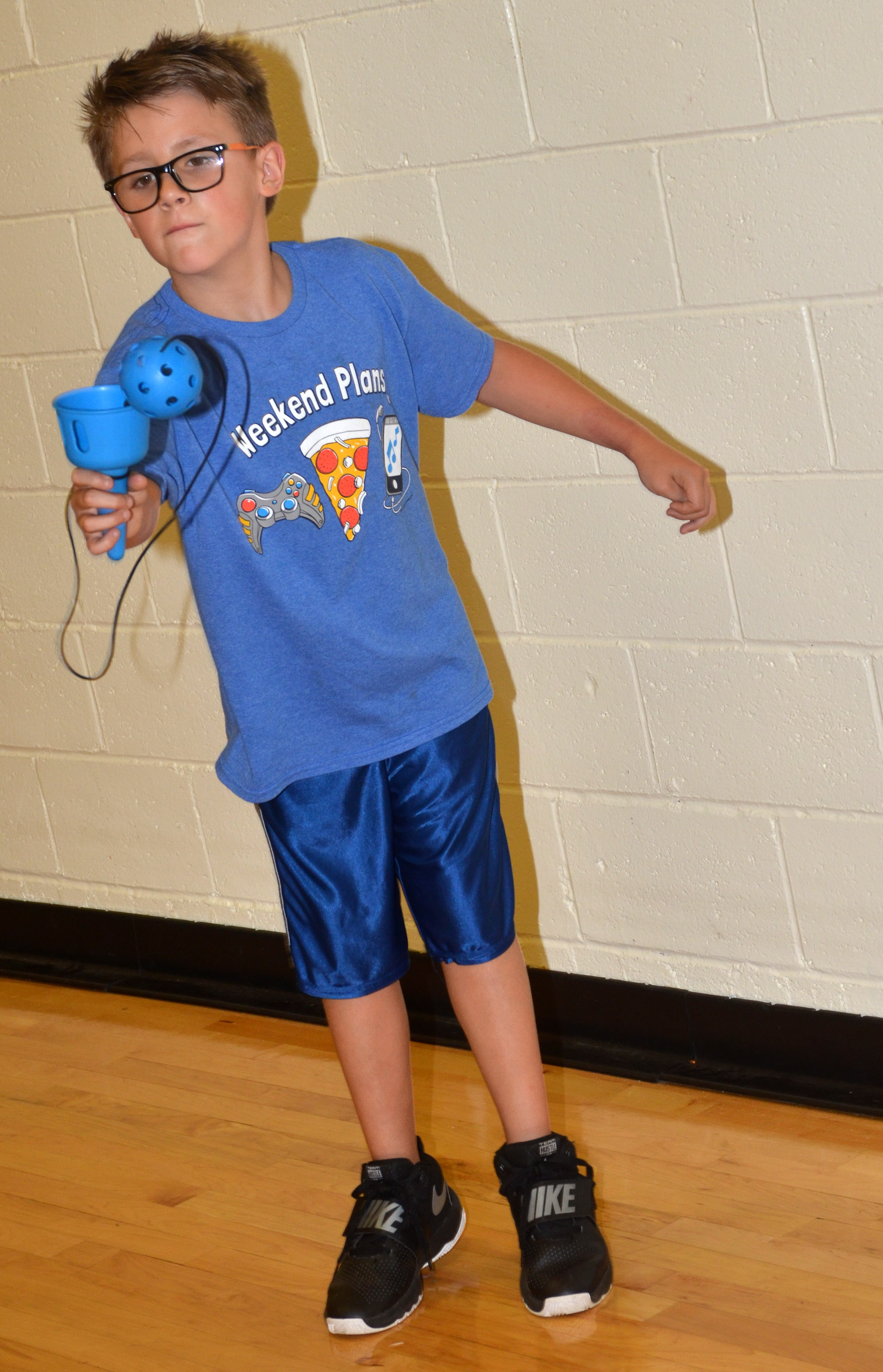CES third-grader Dalton Shively catches a ball in a cup.