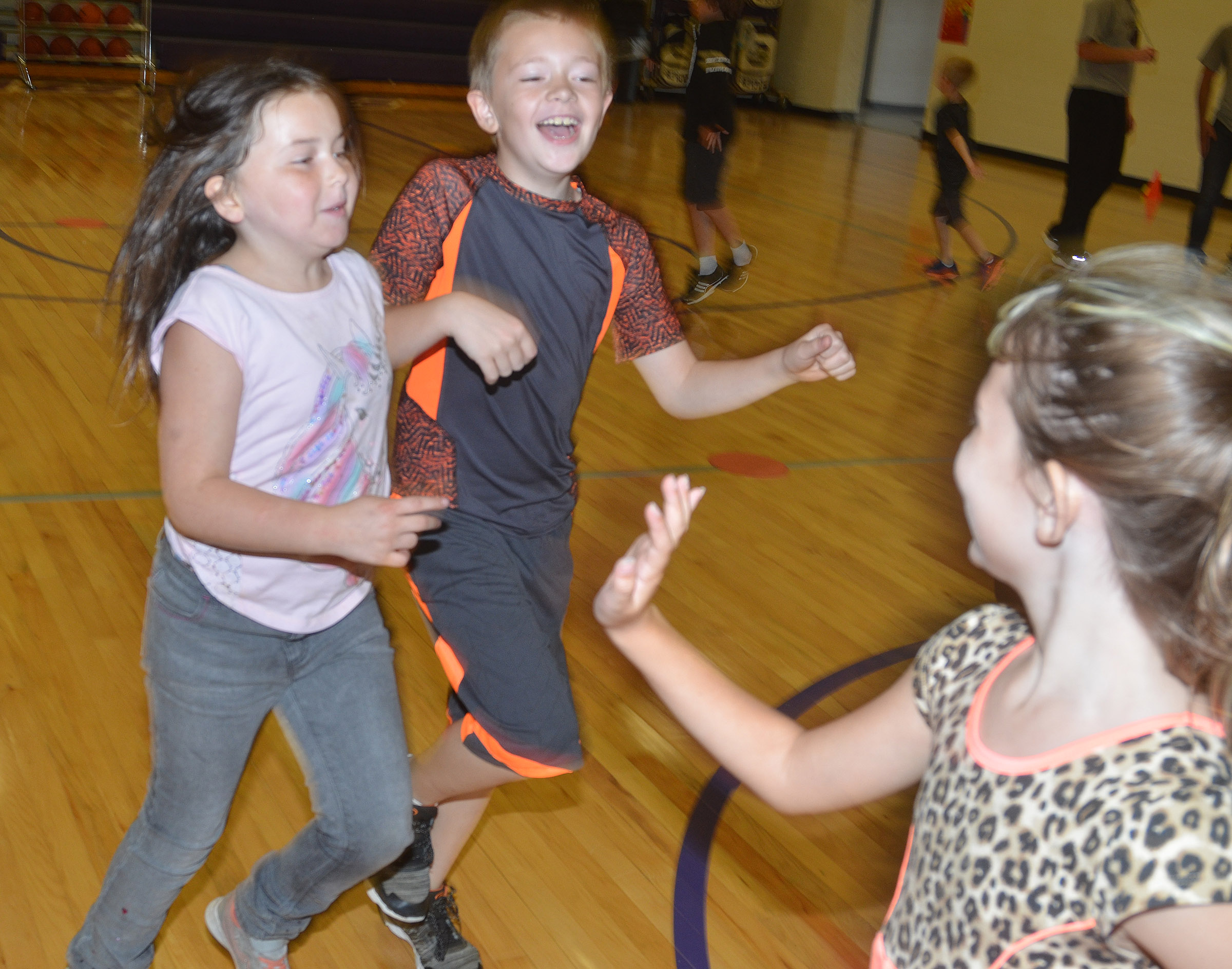 CES third-graders Kendall Cruz, at left, and Alijah Henderson run with their classmates.