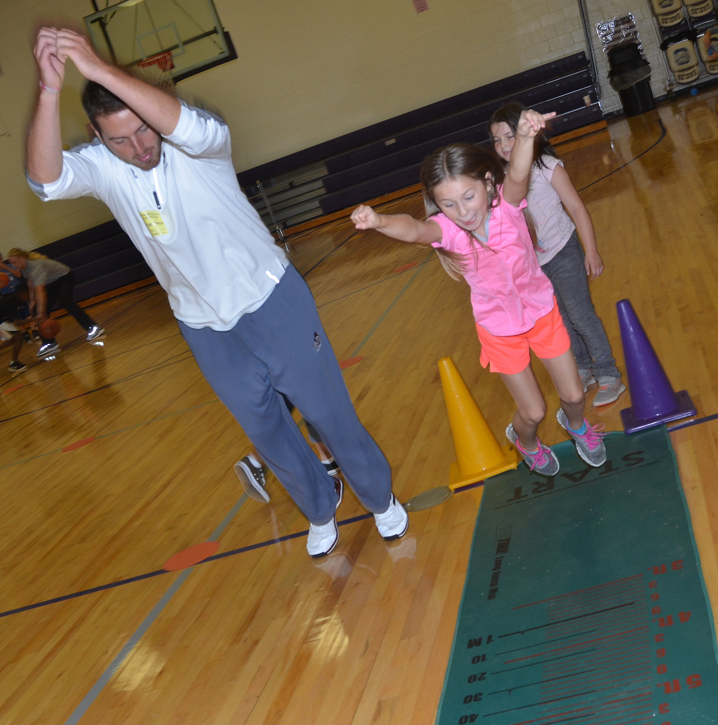 CES third-grader Bryleigh Curry jumps with Campbellsville University student Ryan Grattan.