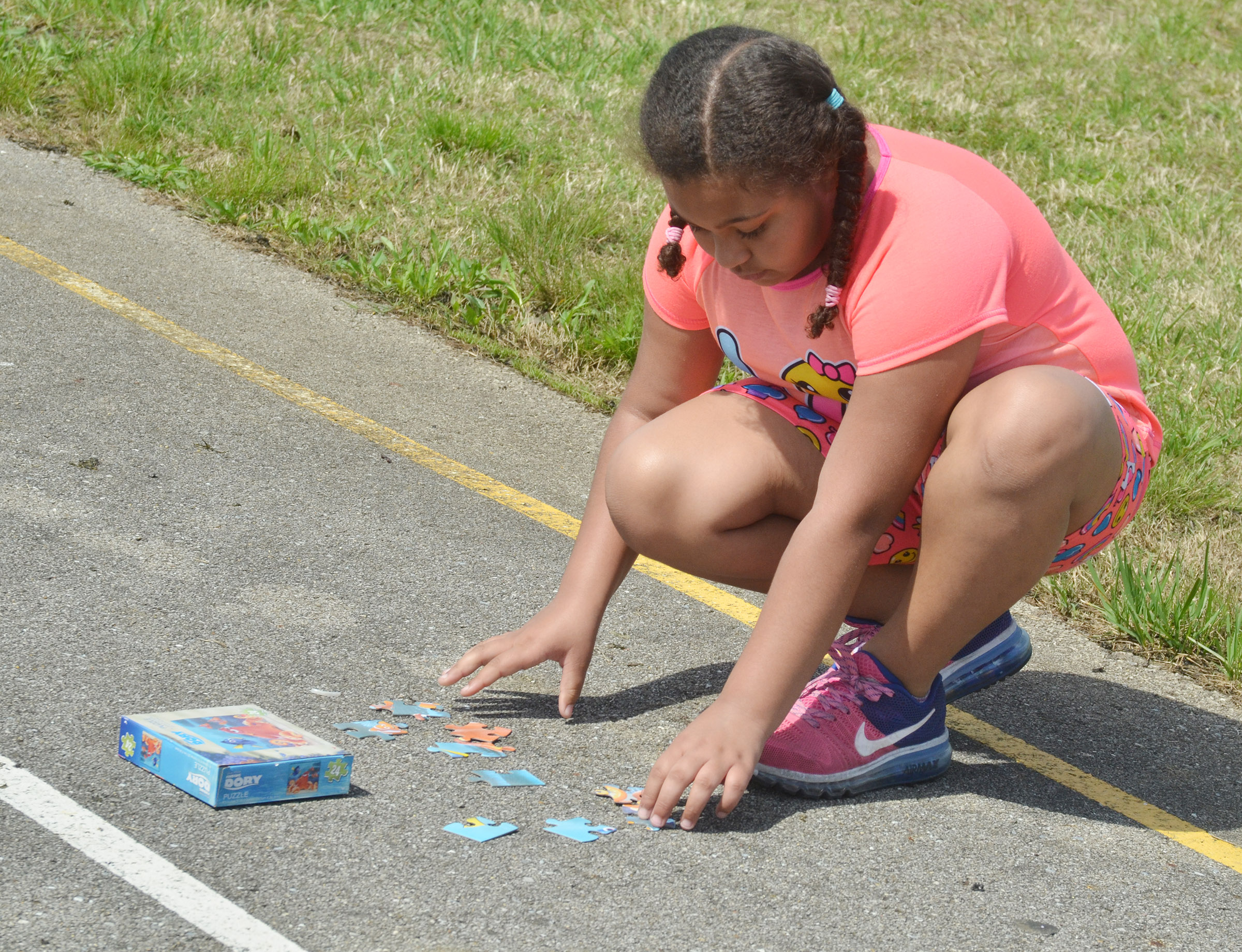 CES third-grader Narissa Barnett tries to put her class's puzzle together.
