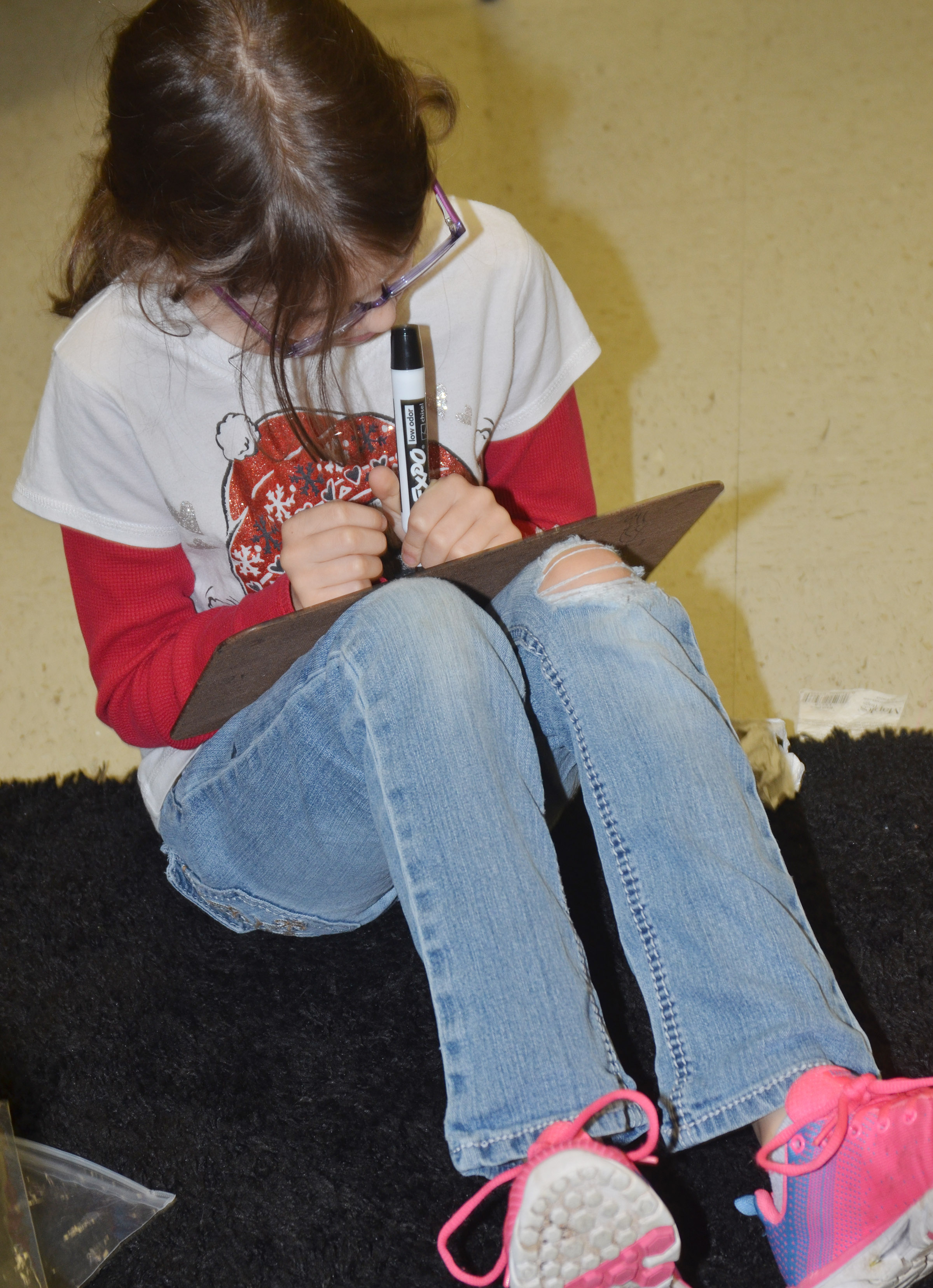 CES third-grader Lilly Wise works a multiplication problem.