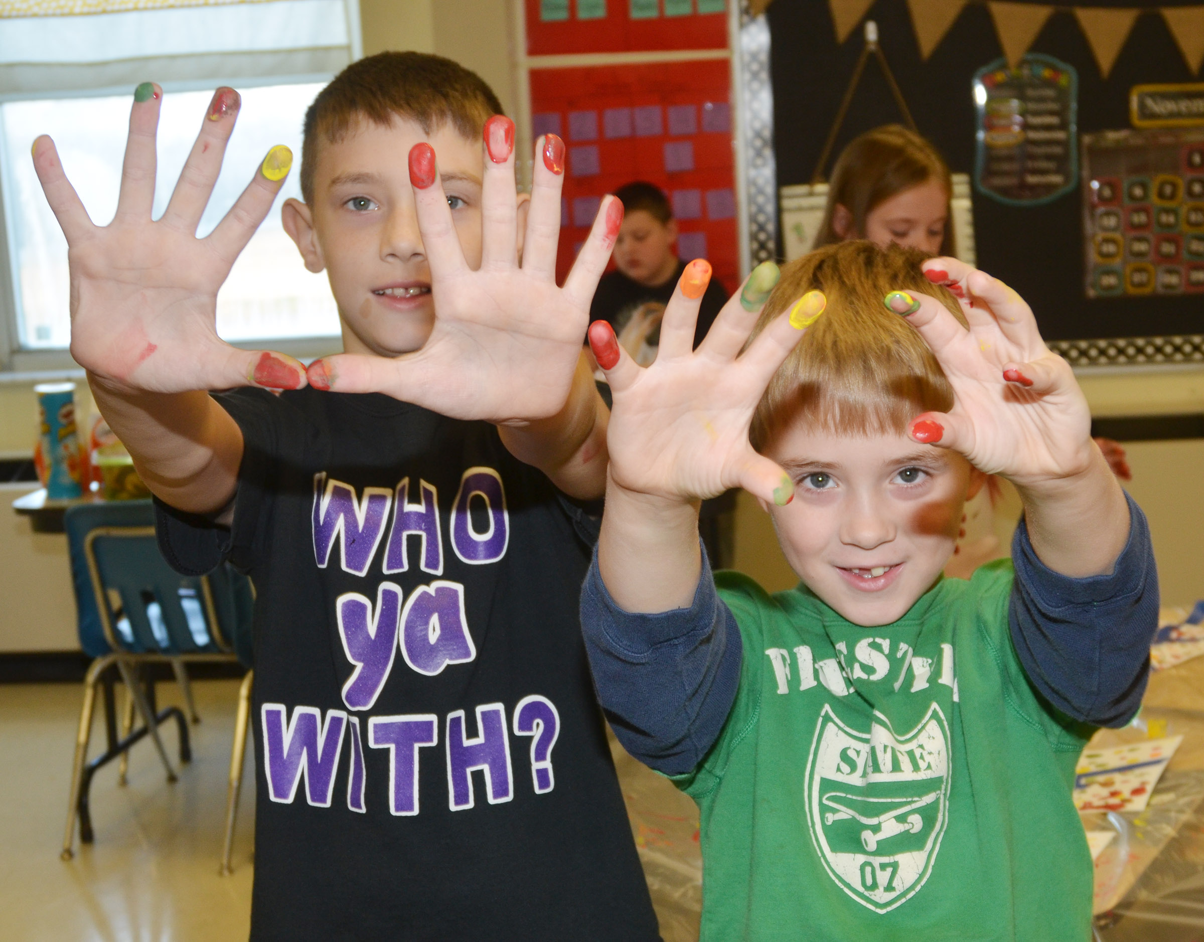 CES third-graders Aidan Wilson, at left, and Devyn Tingle show their paint-covered hands.