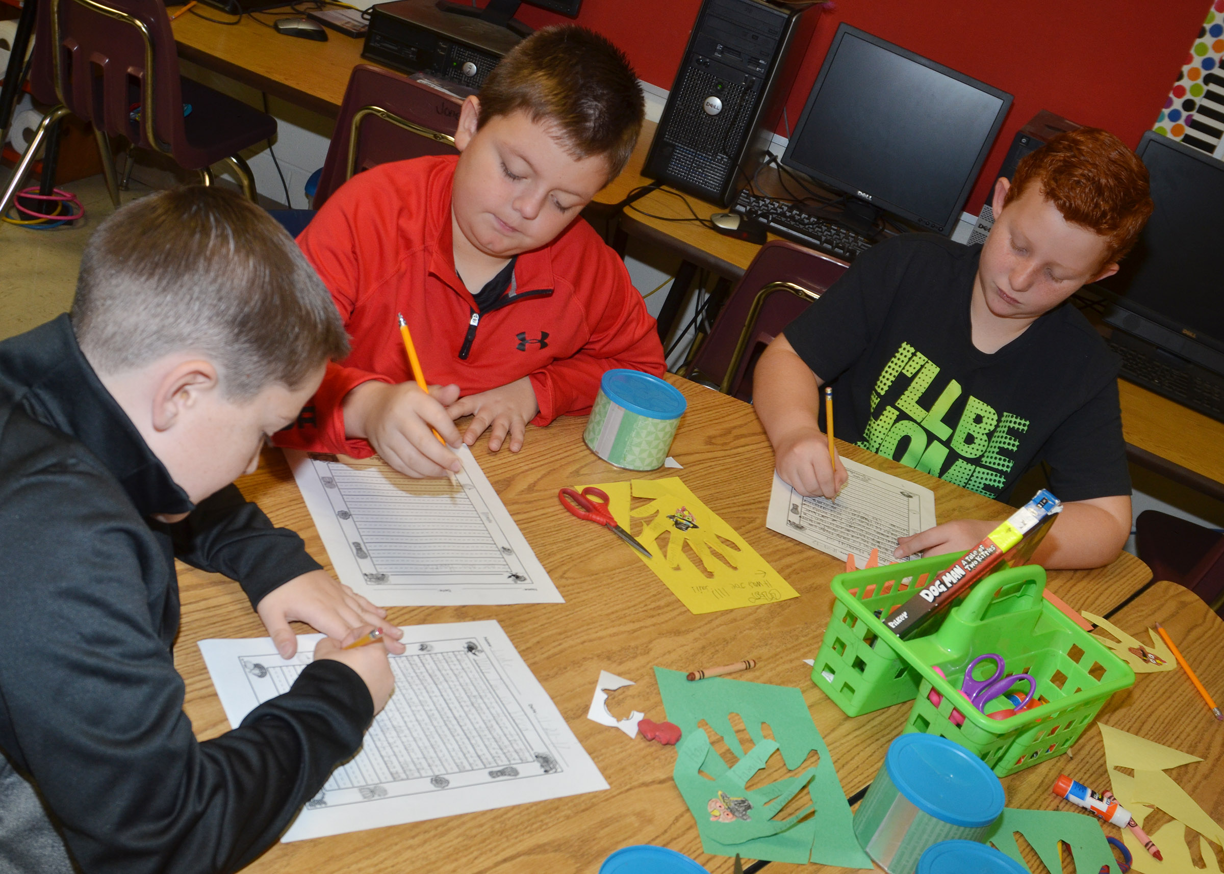 From left, CES third-graders Luke Adkins, Hayden Maupin and Reece Swafford write about what they are thankful for.