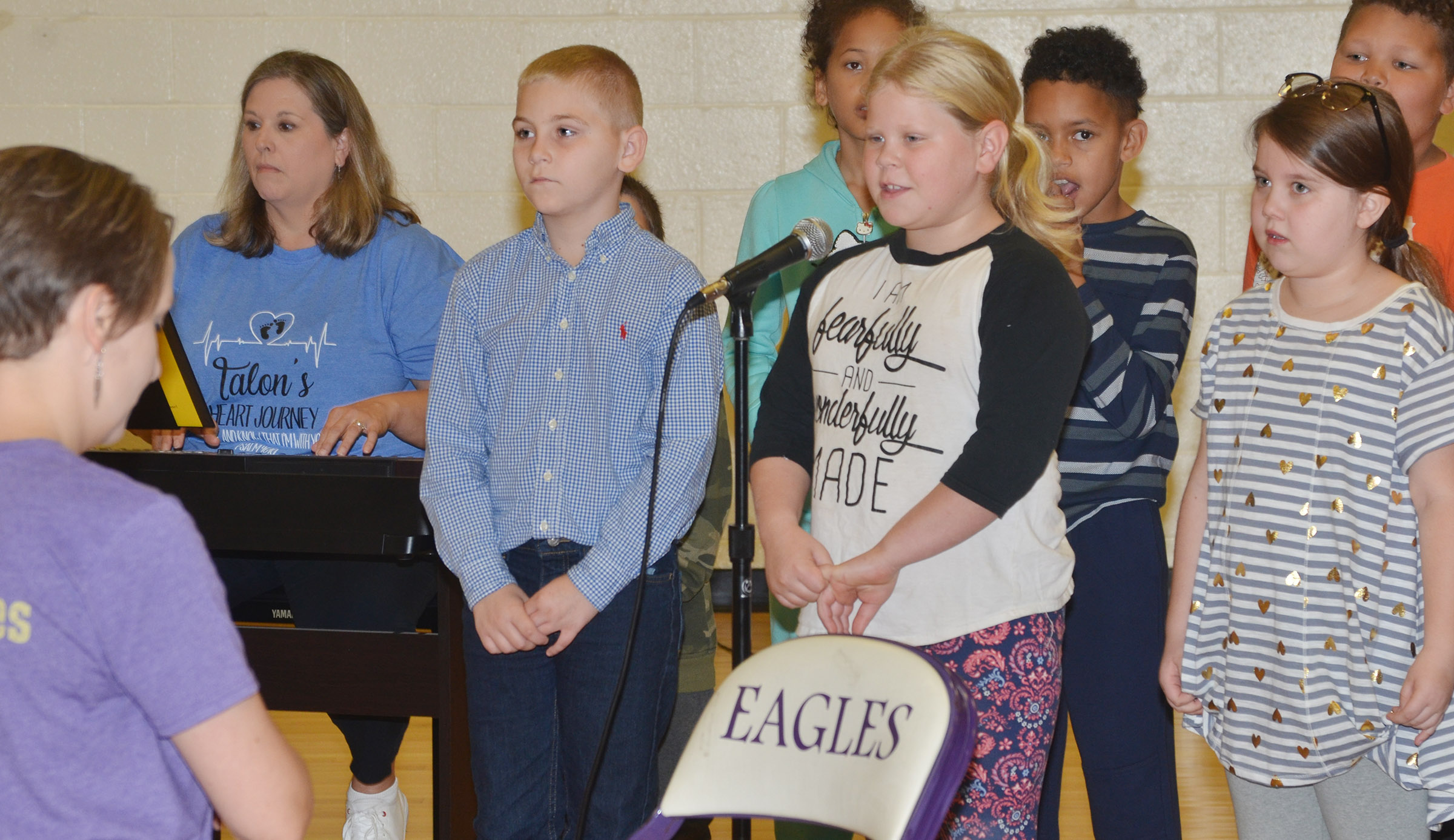 CES third-grader Lily Coots sings a solo.