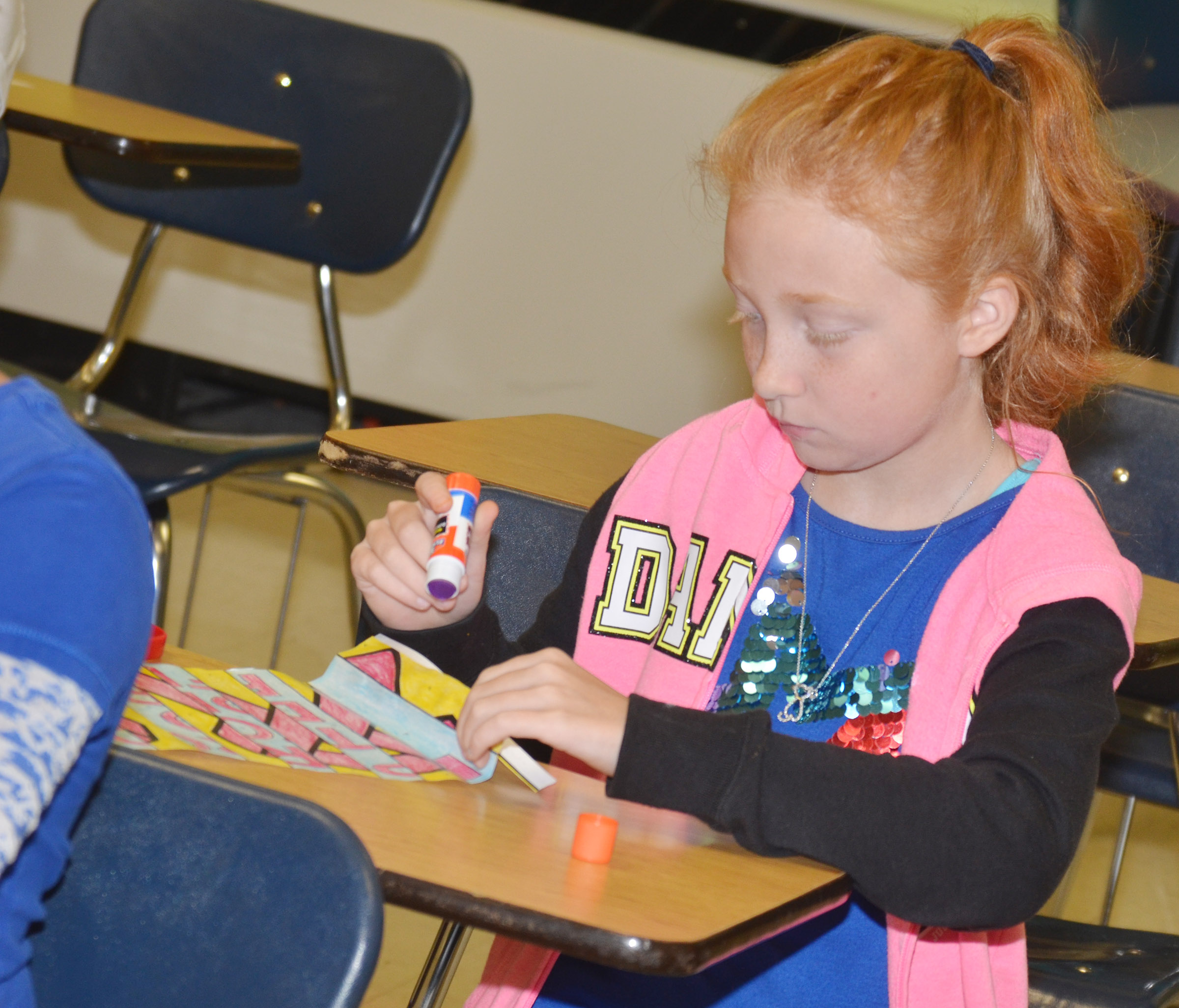 CES fourth-grader Savannah Wethington folds and glues her agamograph.