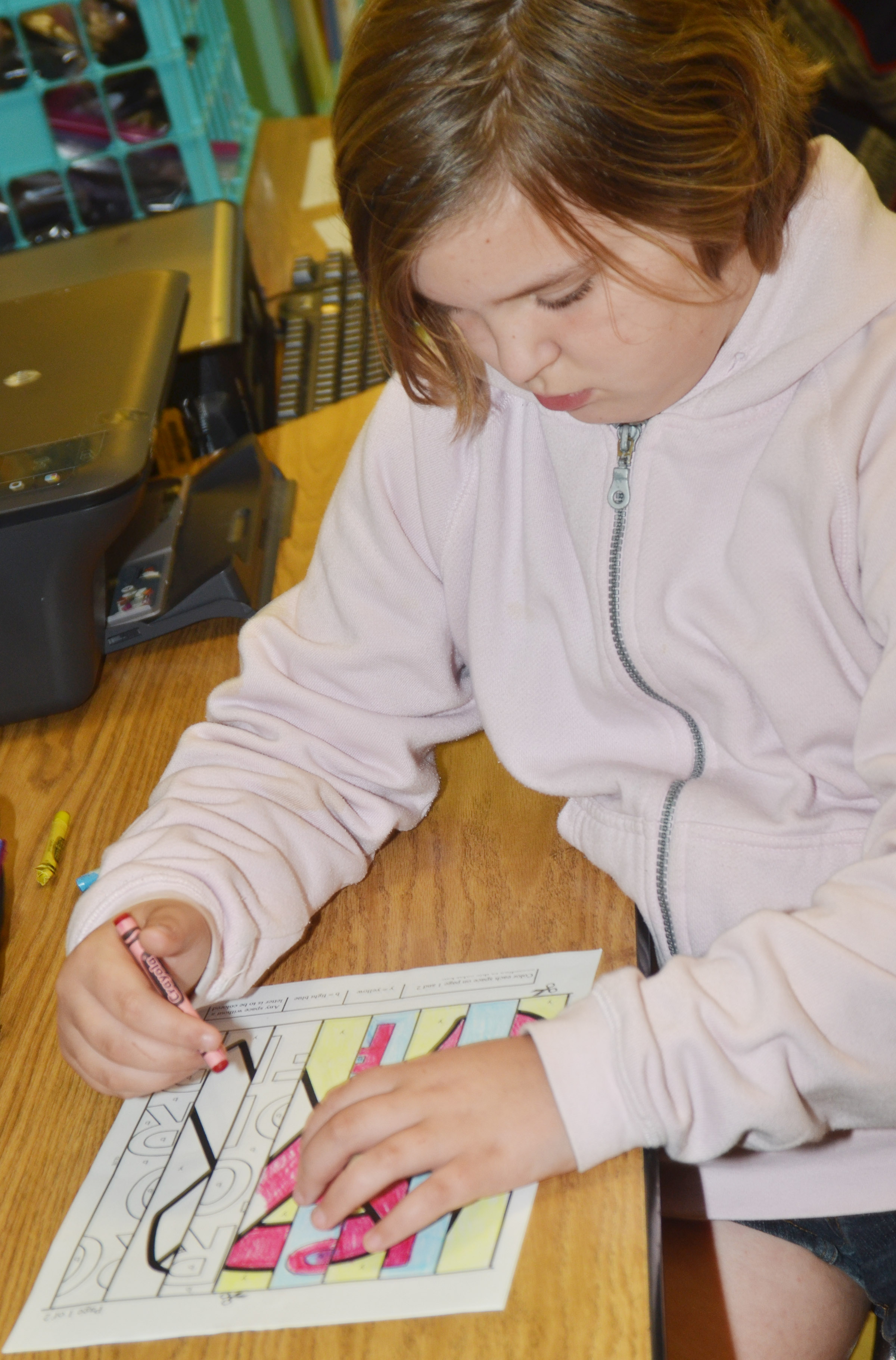 CES fourth-grader Mary James colors her agamograph.