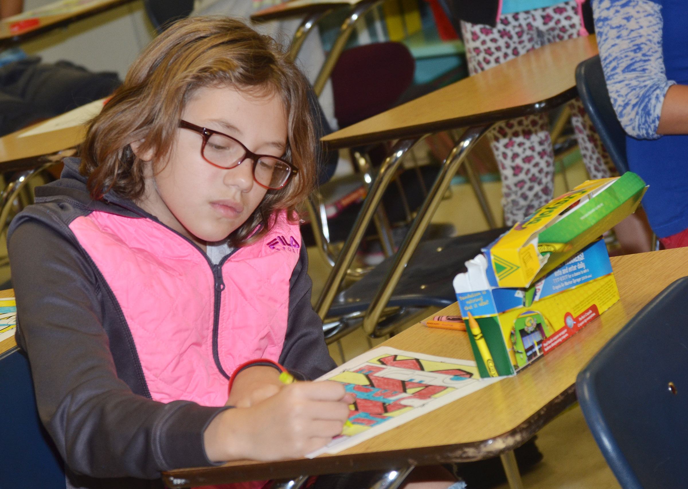 CES fourth-grader Trinity McFarland colors her agamograph.