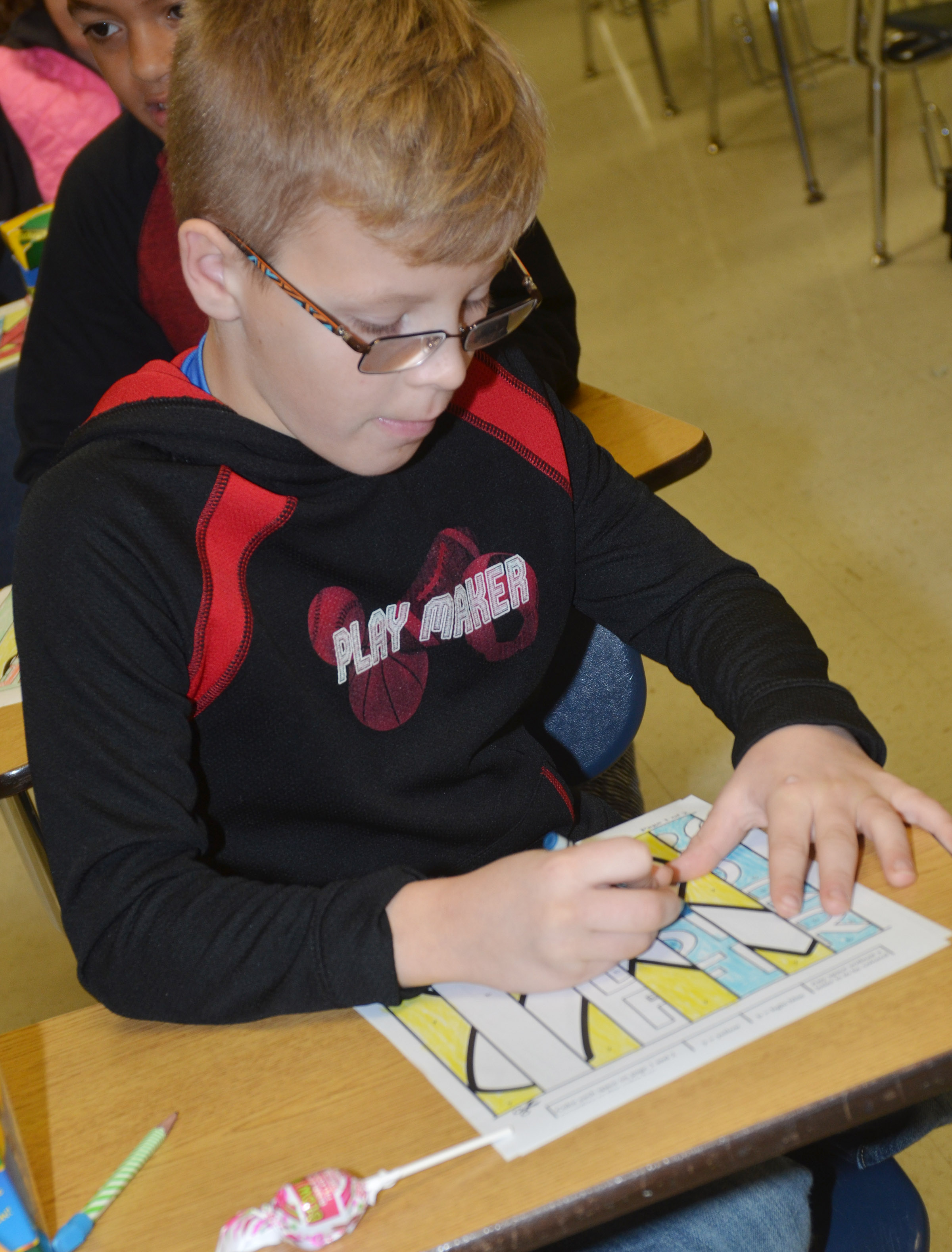 CES fourth-grader Ethan Irwin colors his agamograph.
