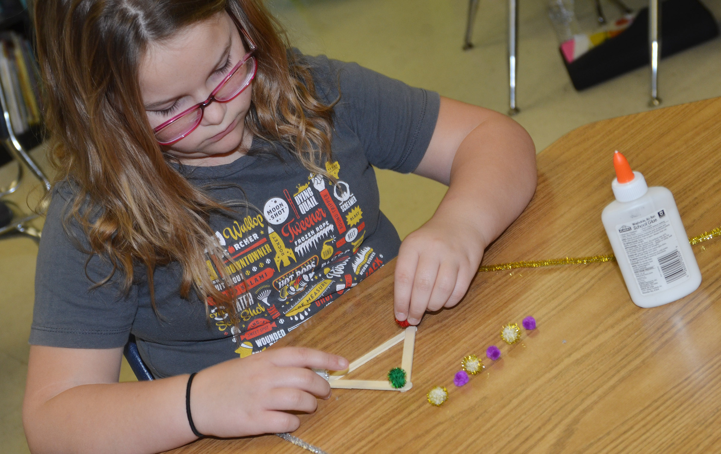 CES fourth-grader Eleana Brewer makes an ornament.