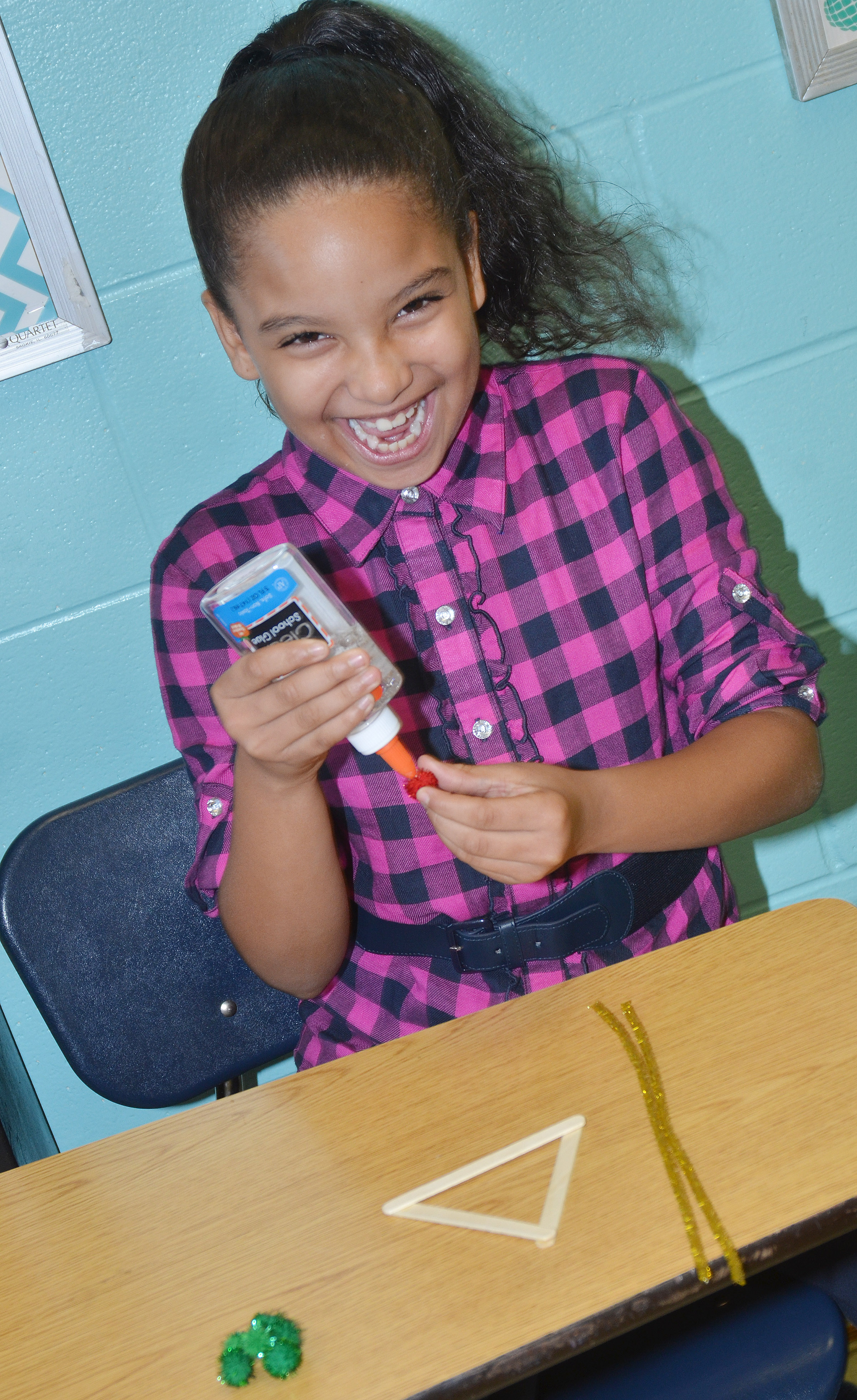 CES fourth-grader Aleecia Knezevic makes an ornament.
