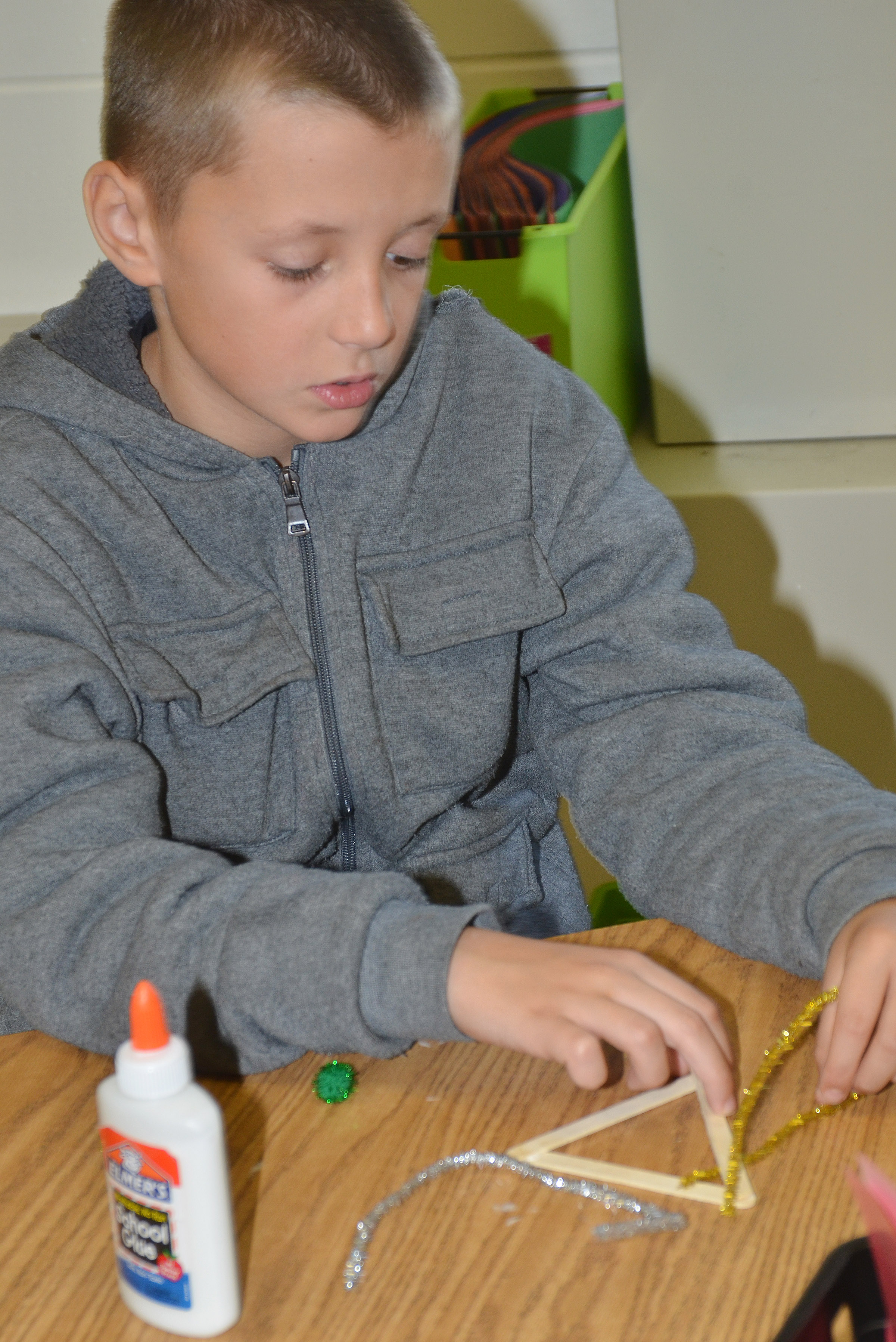 CES fourth-grader Cameron Taylor makes an ornament.