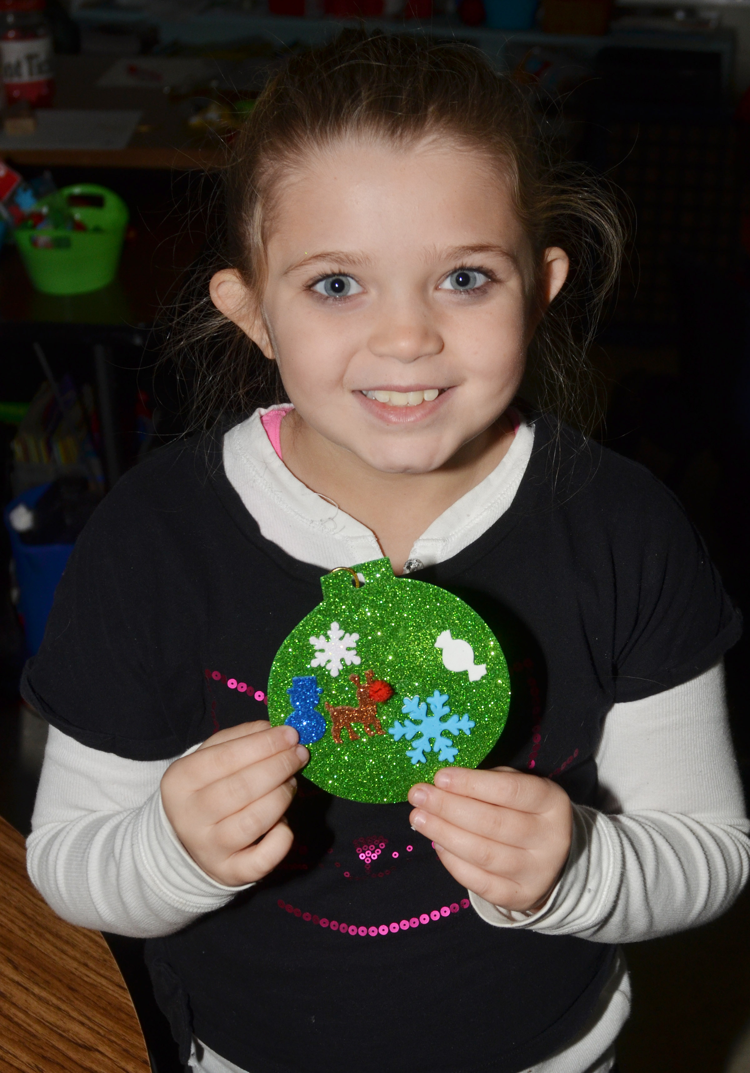 CES fourth-grader Chyanne Christie holds her ornament.