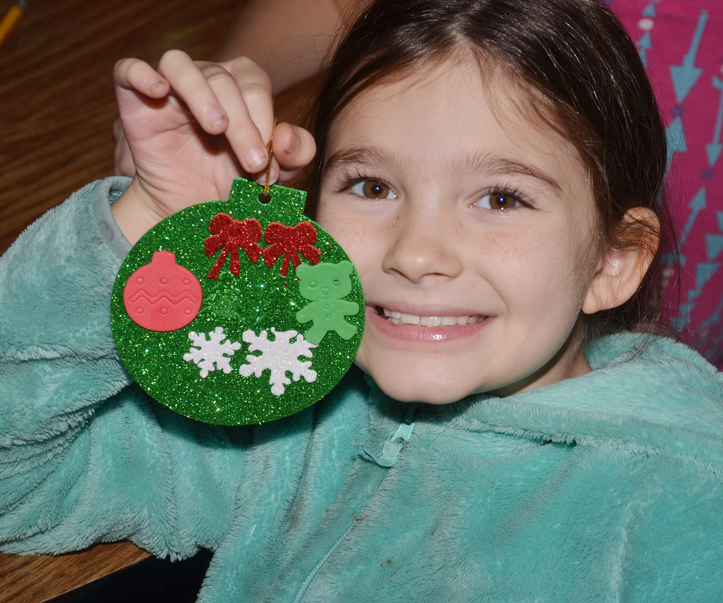 CES fourth-grader Destiny Abell holds her ornament.
